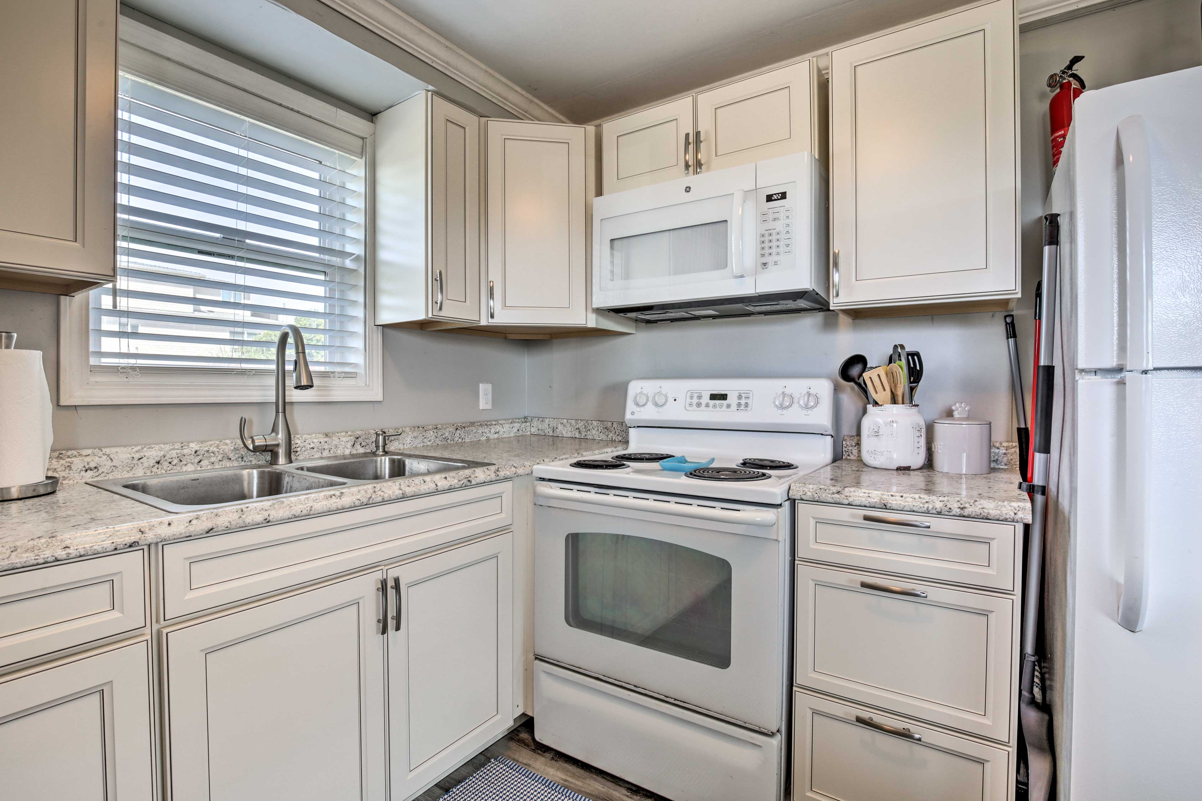 The well-equipped cooking space features wraparound counters for prep!