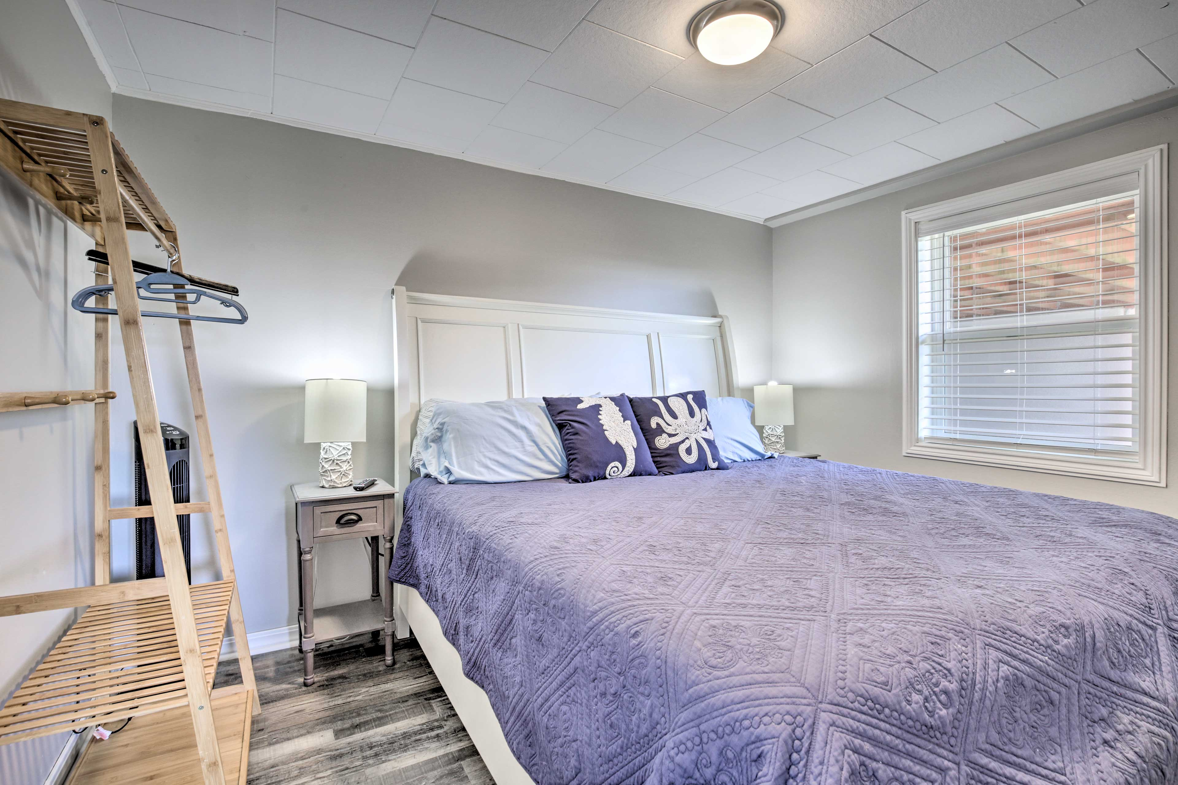 A king bed furnishes the master bedroom.
