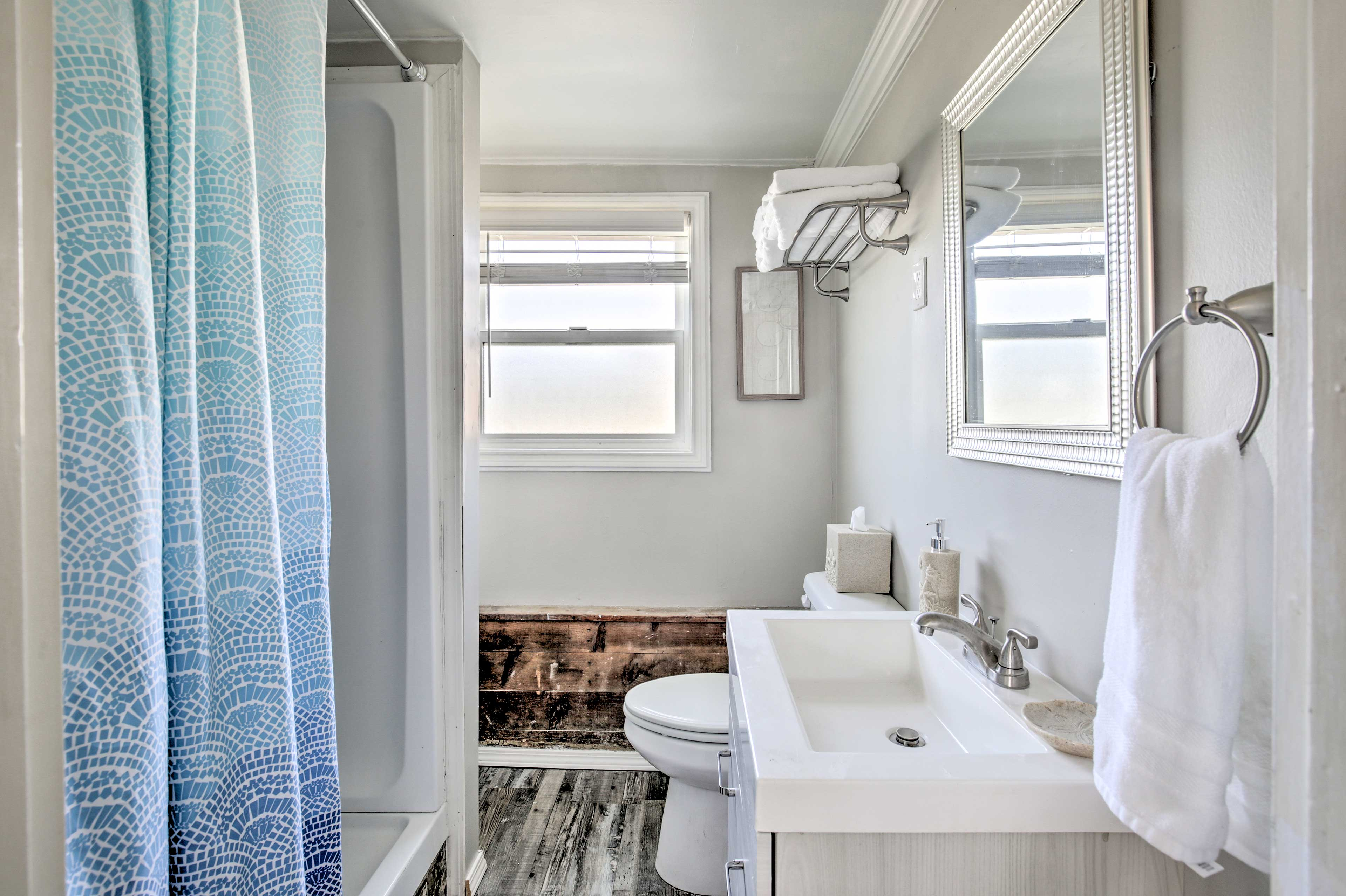 The modern style continues in the full bathroom, complete with a shower.