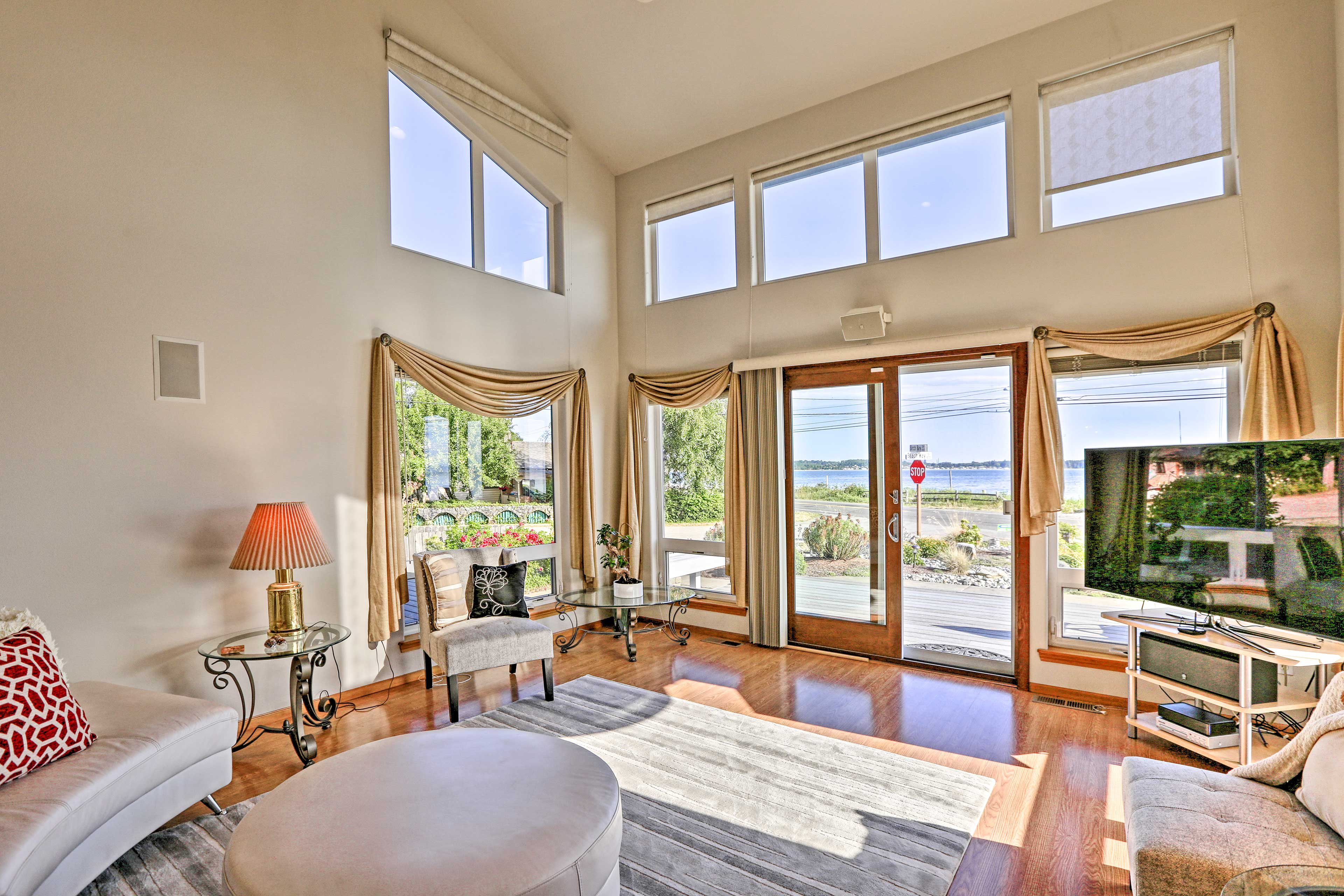 High ceilings and large windows bring natural light to the space.