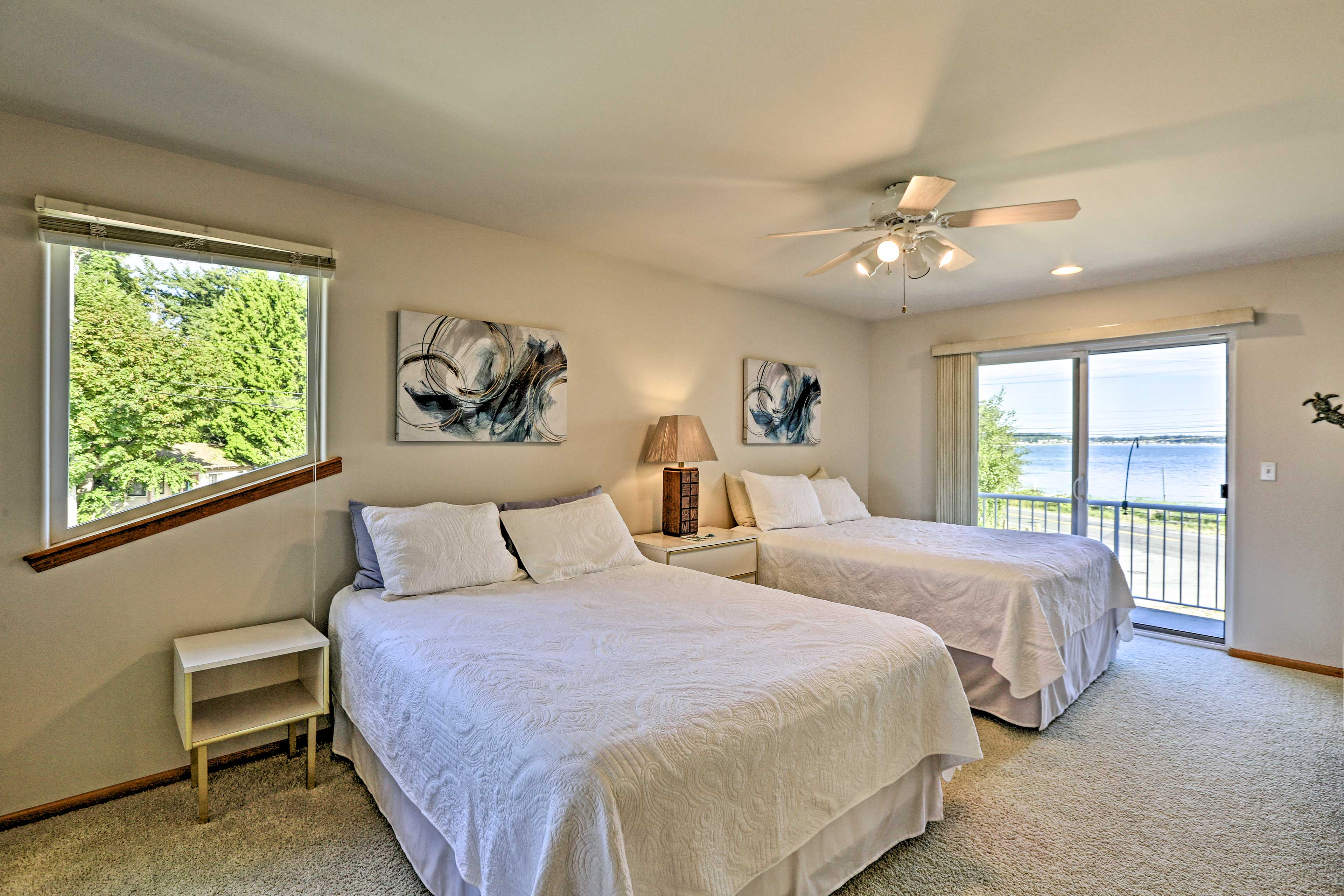Sleep four in this bright bedroom with two queen beds.