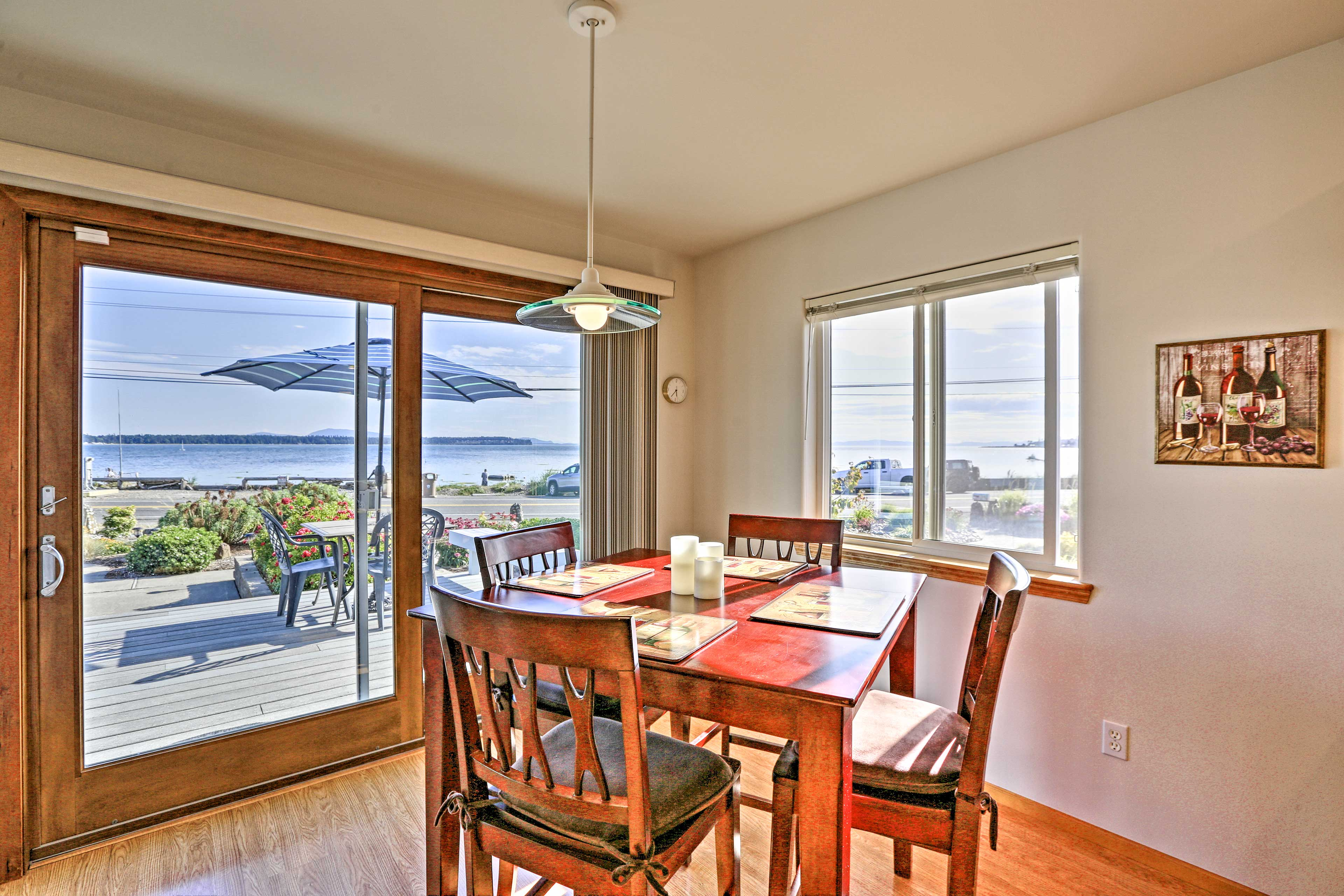 The home boasts both indoor and outdoor dining areas.