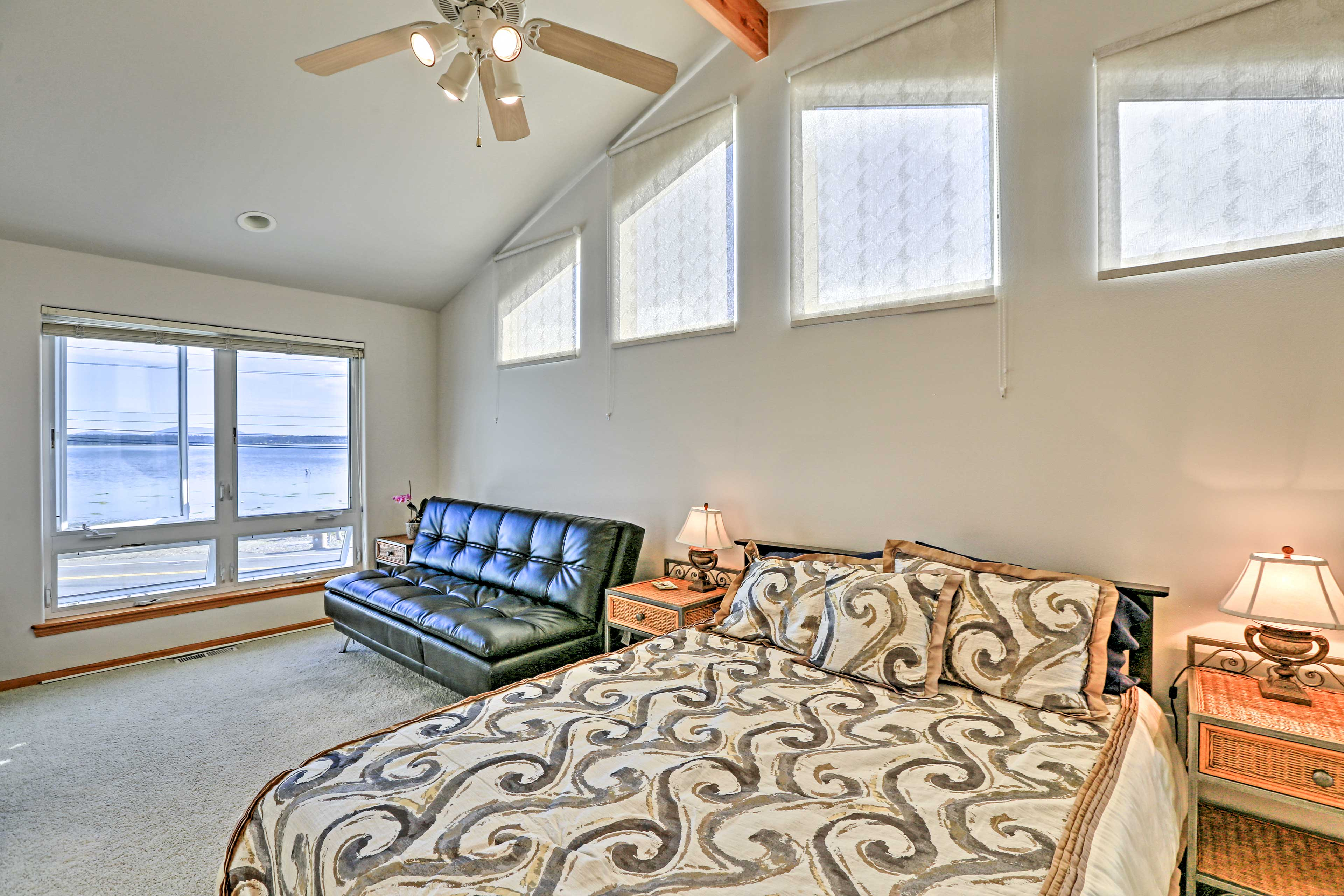 The bedroom's futon allows for additional sleeping space.