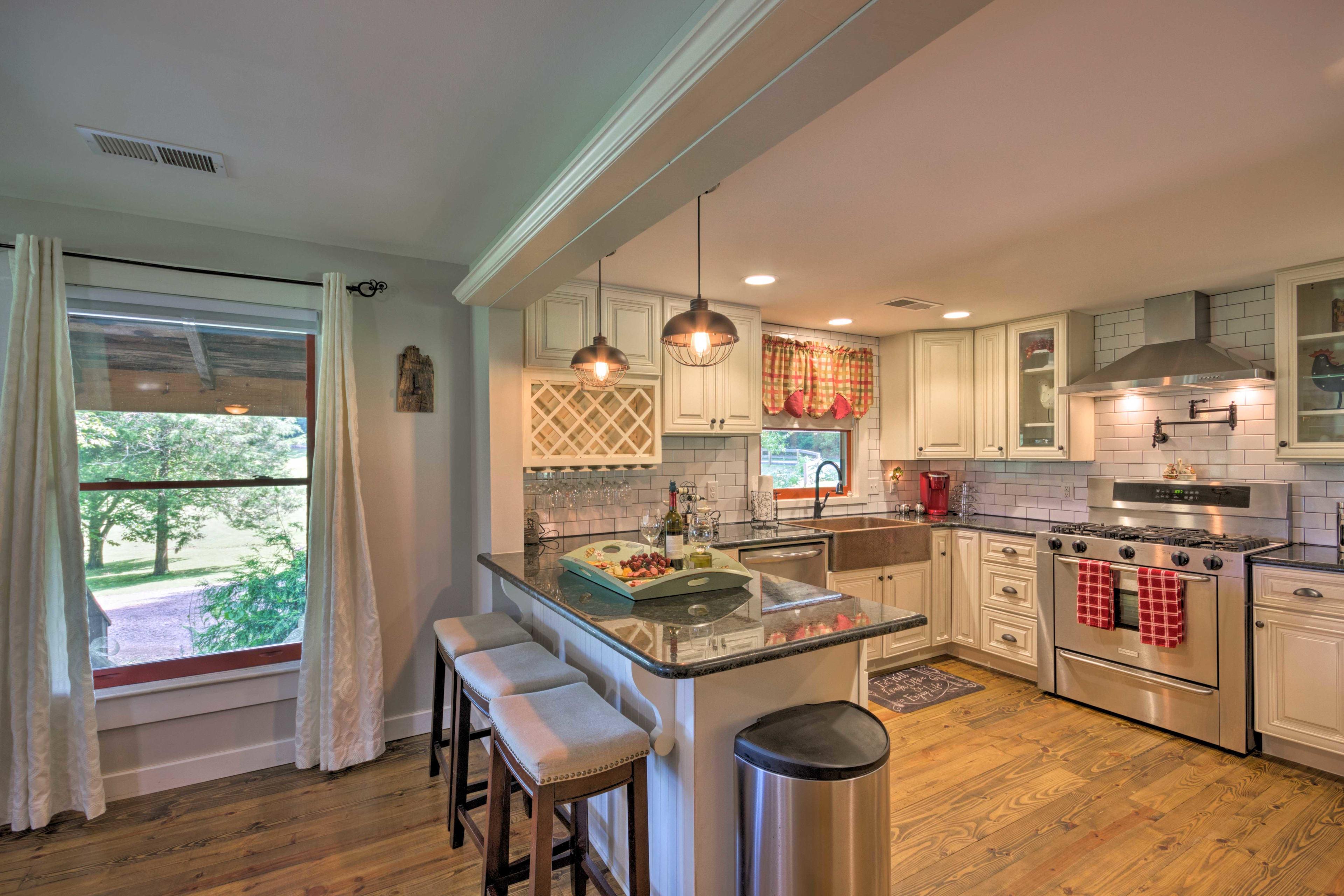 Sleek hardwood floors span the open living area/kitchen.