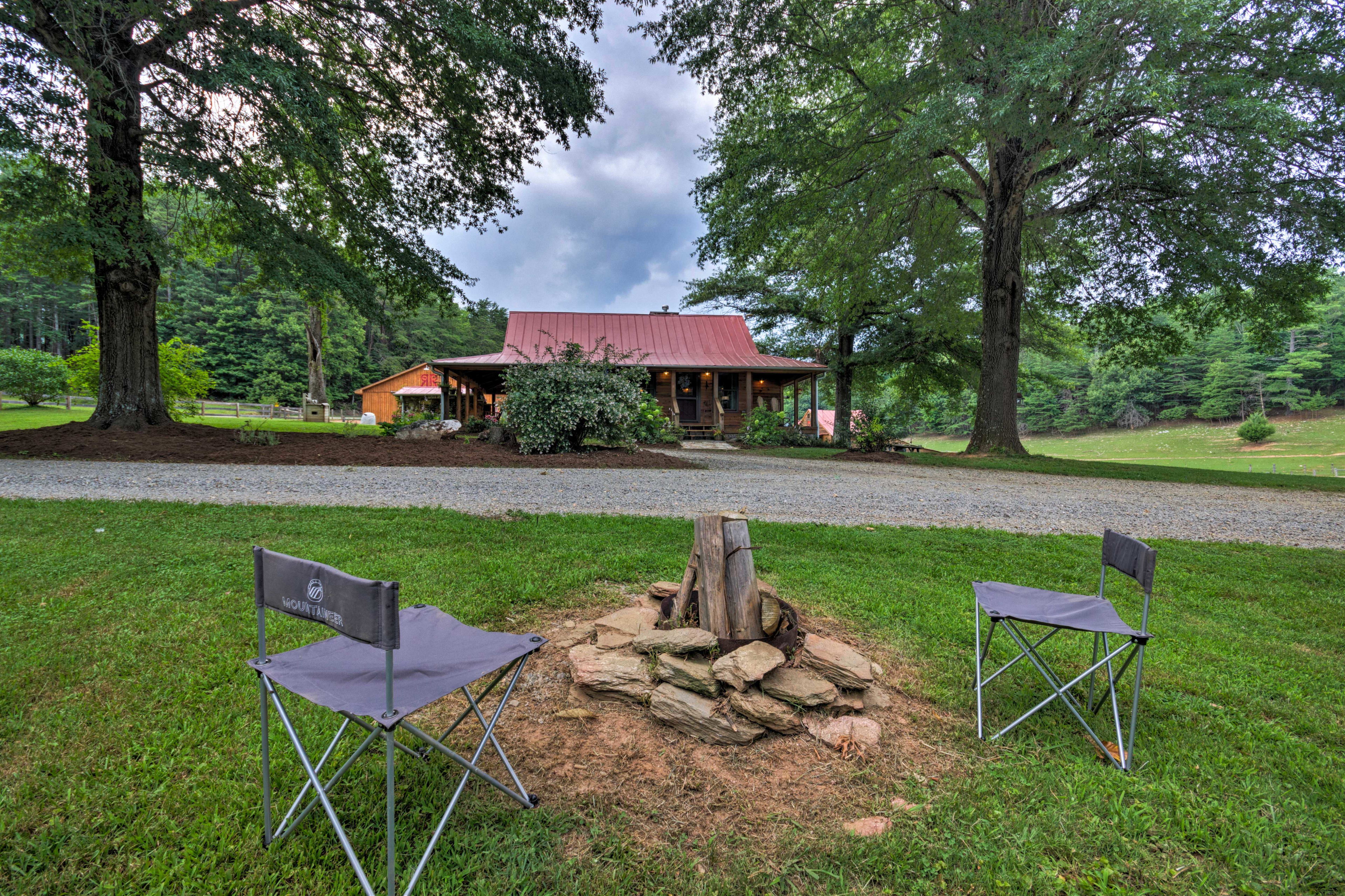 A fire pit is also featured in the yard.