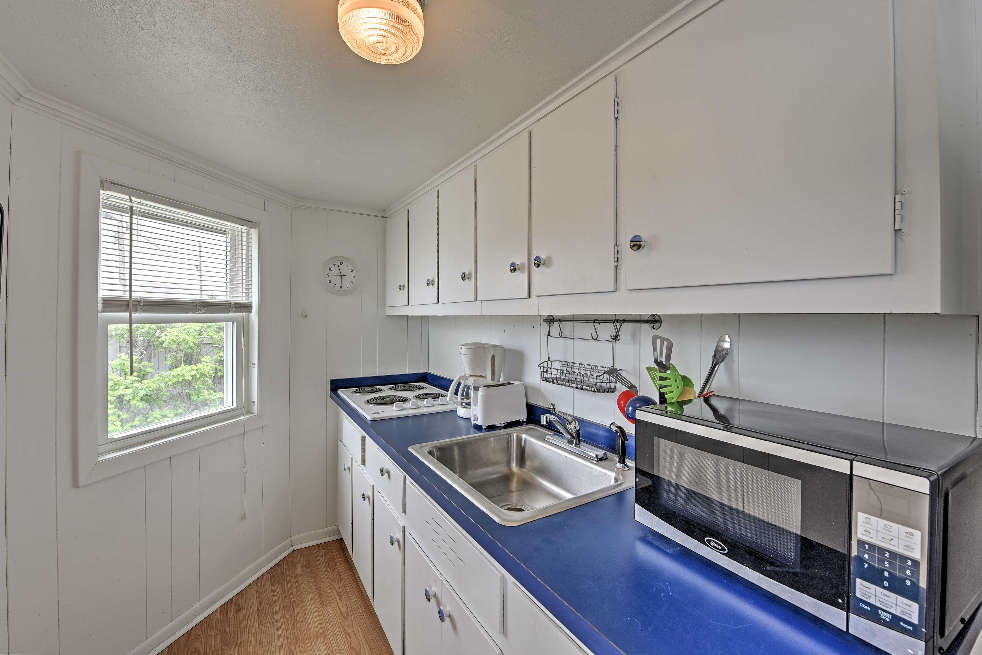 This kitchenette comes well equipped with everything you need to prepare meals.