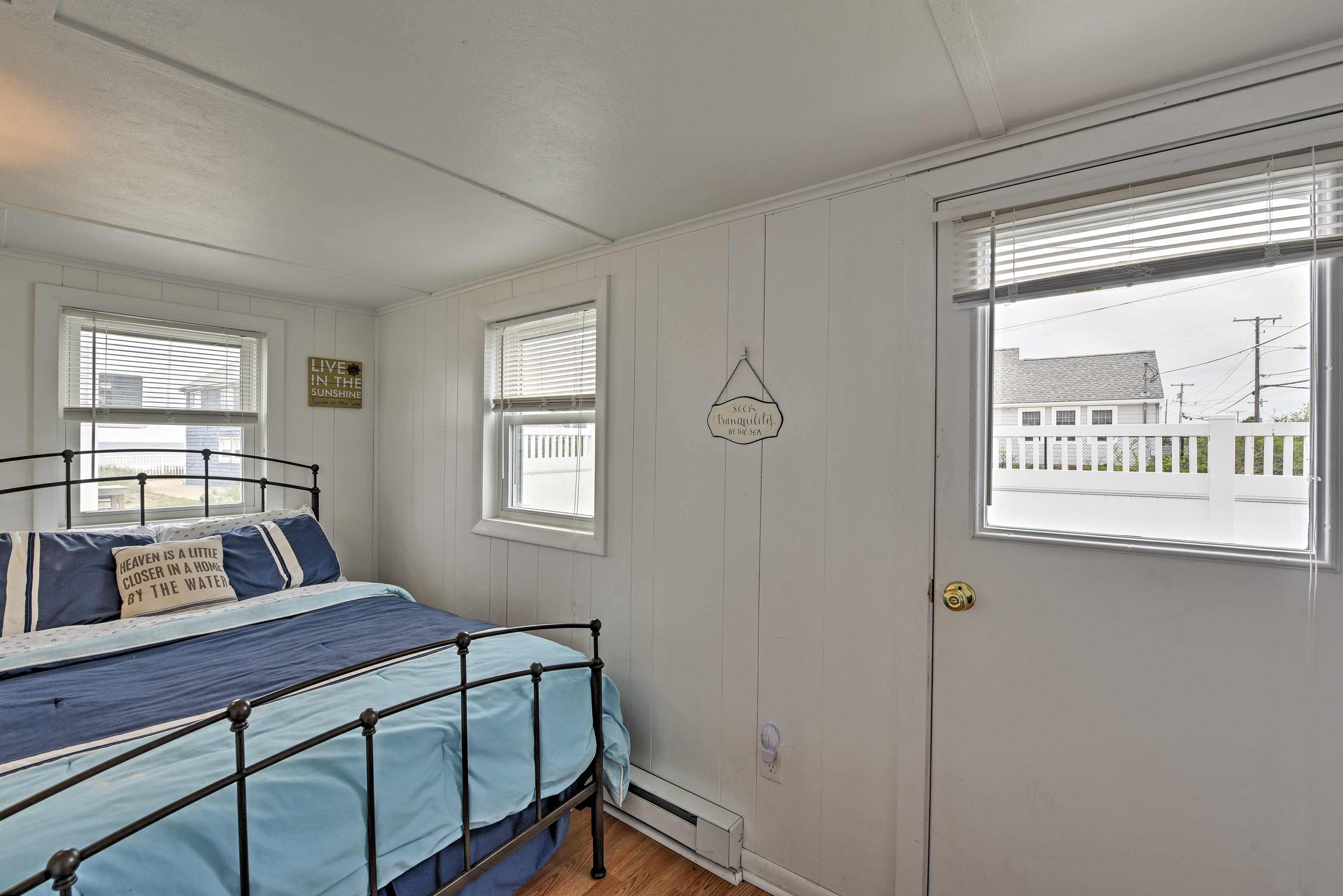 This bedroom provides direct access to the private yard.