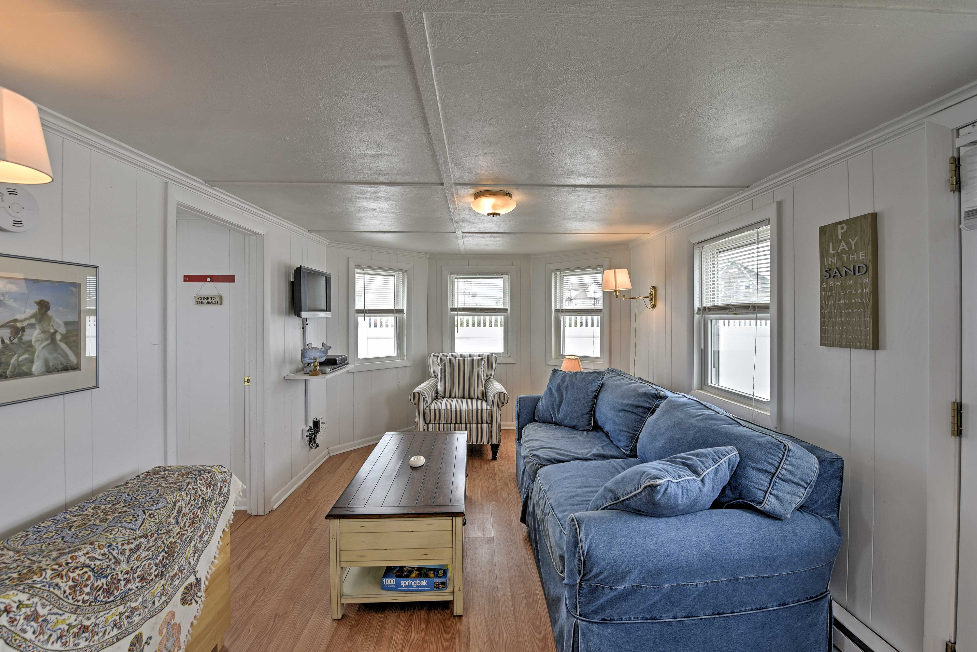 The living room is furnished with comfortable, plush furniture.