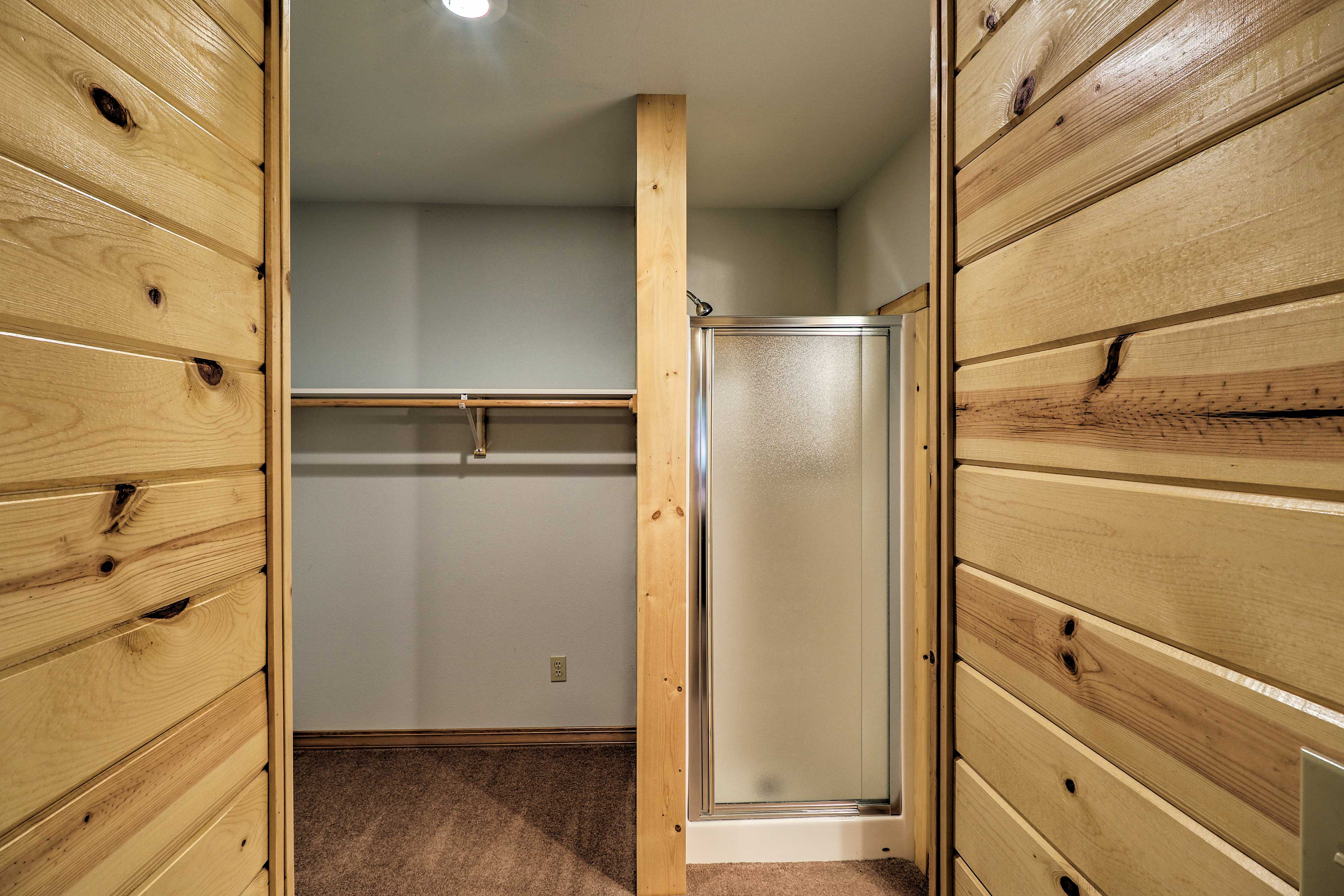 The closet space has a walk-in shower.