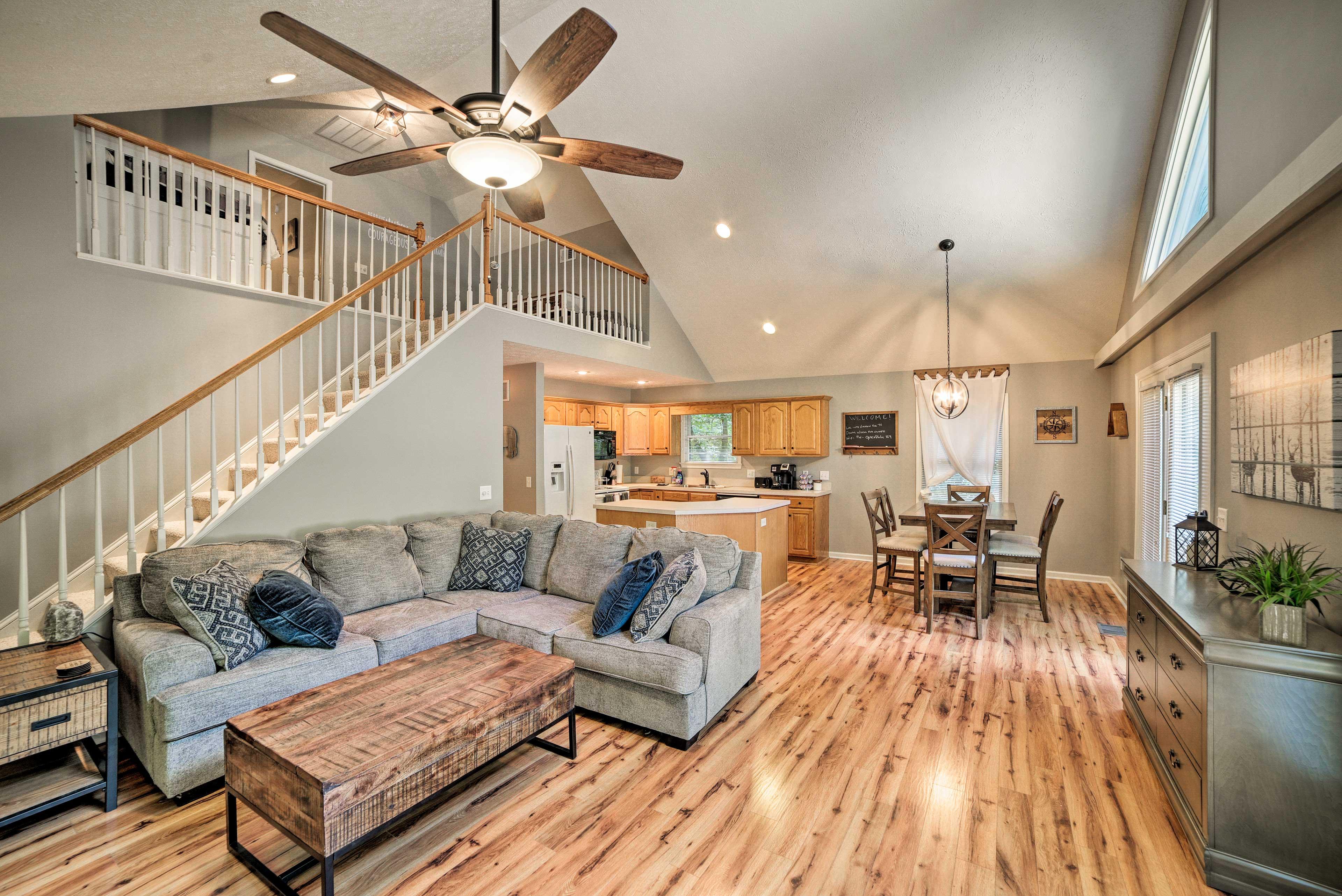 Sleek hardwood floors span the open living area.
