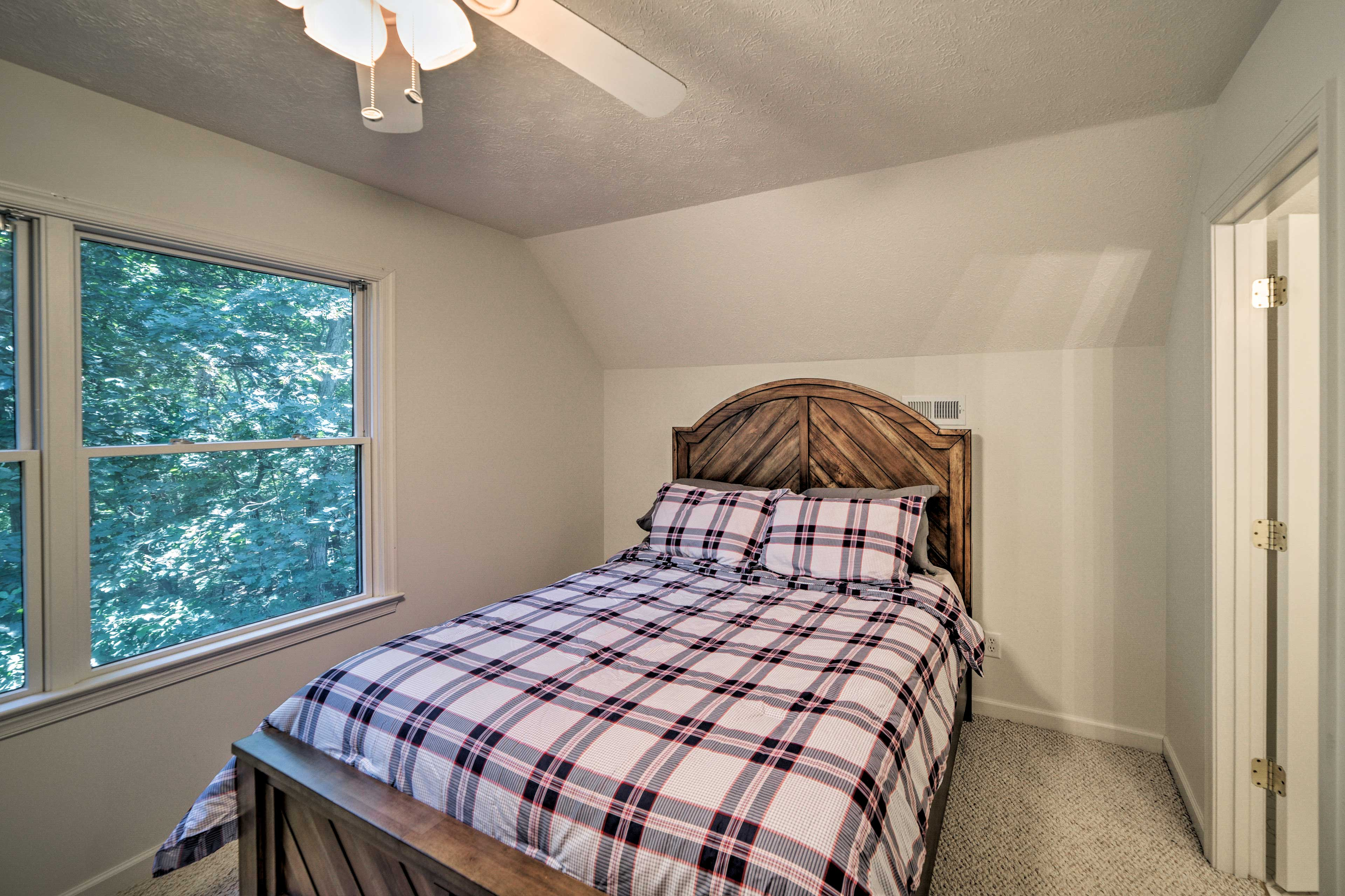 The third bedroom features another queen-sized bed.