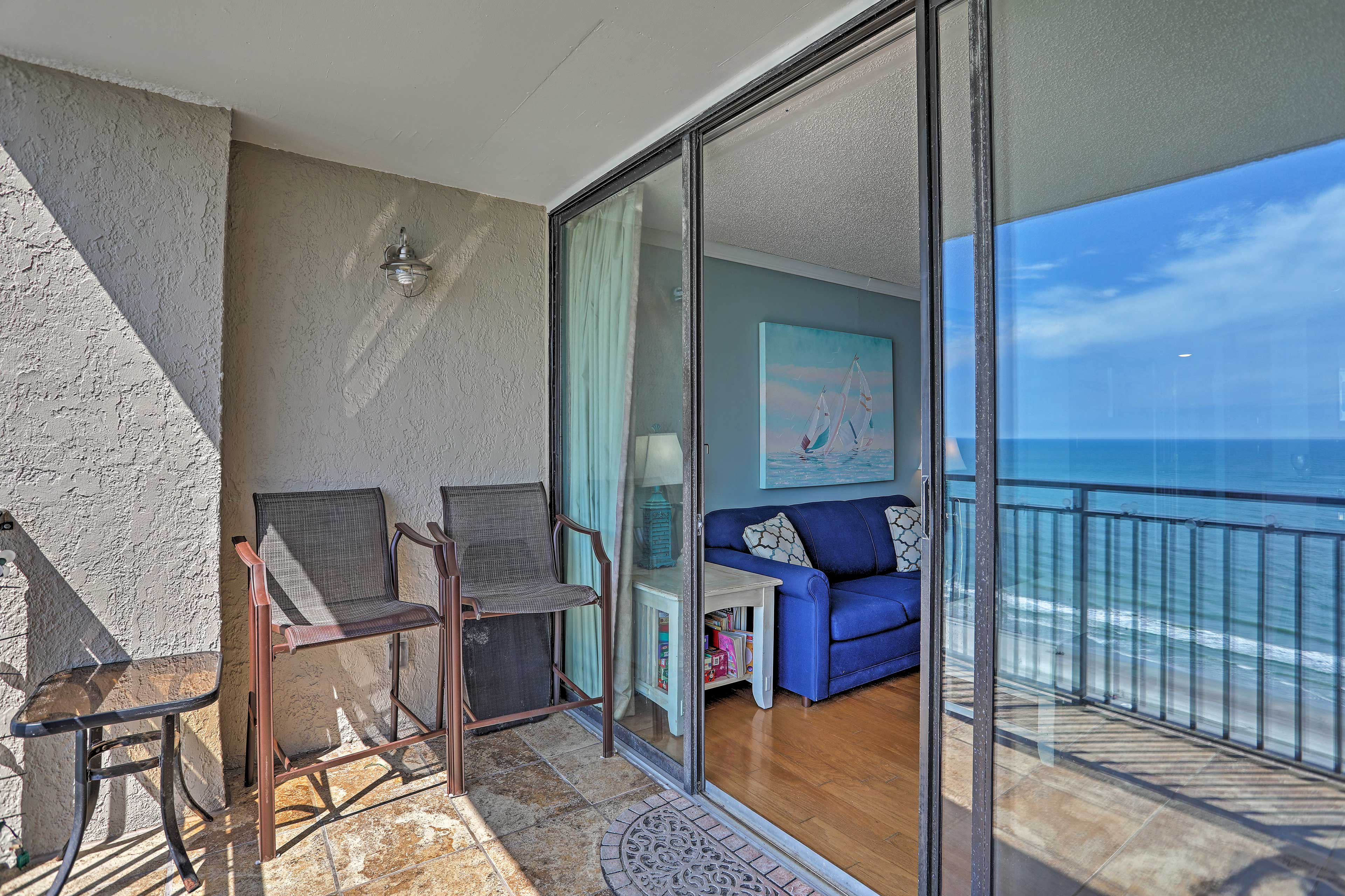 Enjoy the ocean breeze from the balcony and living area.
