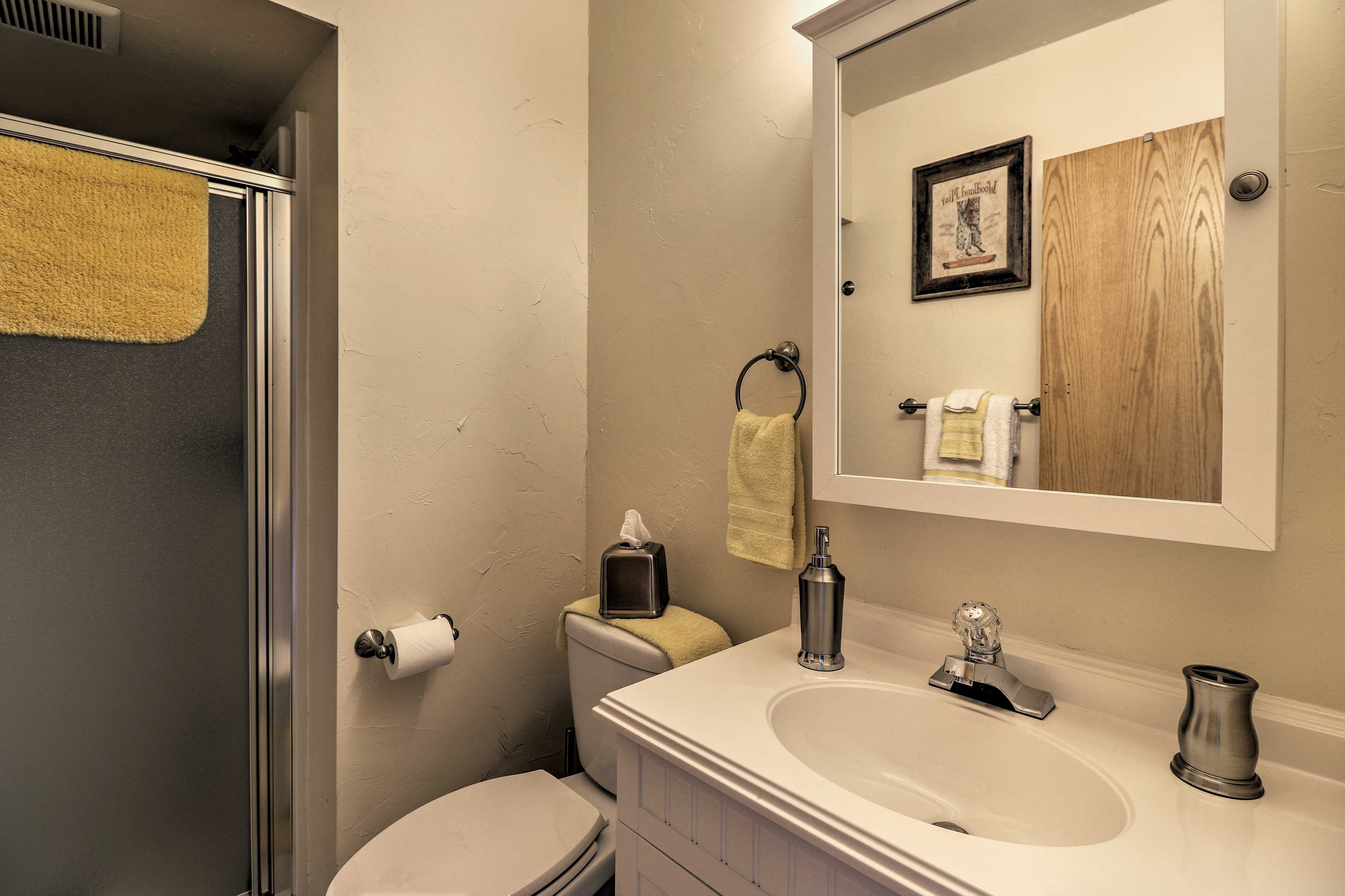Set in the corner, the full bathroom features a shower.