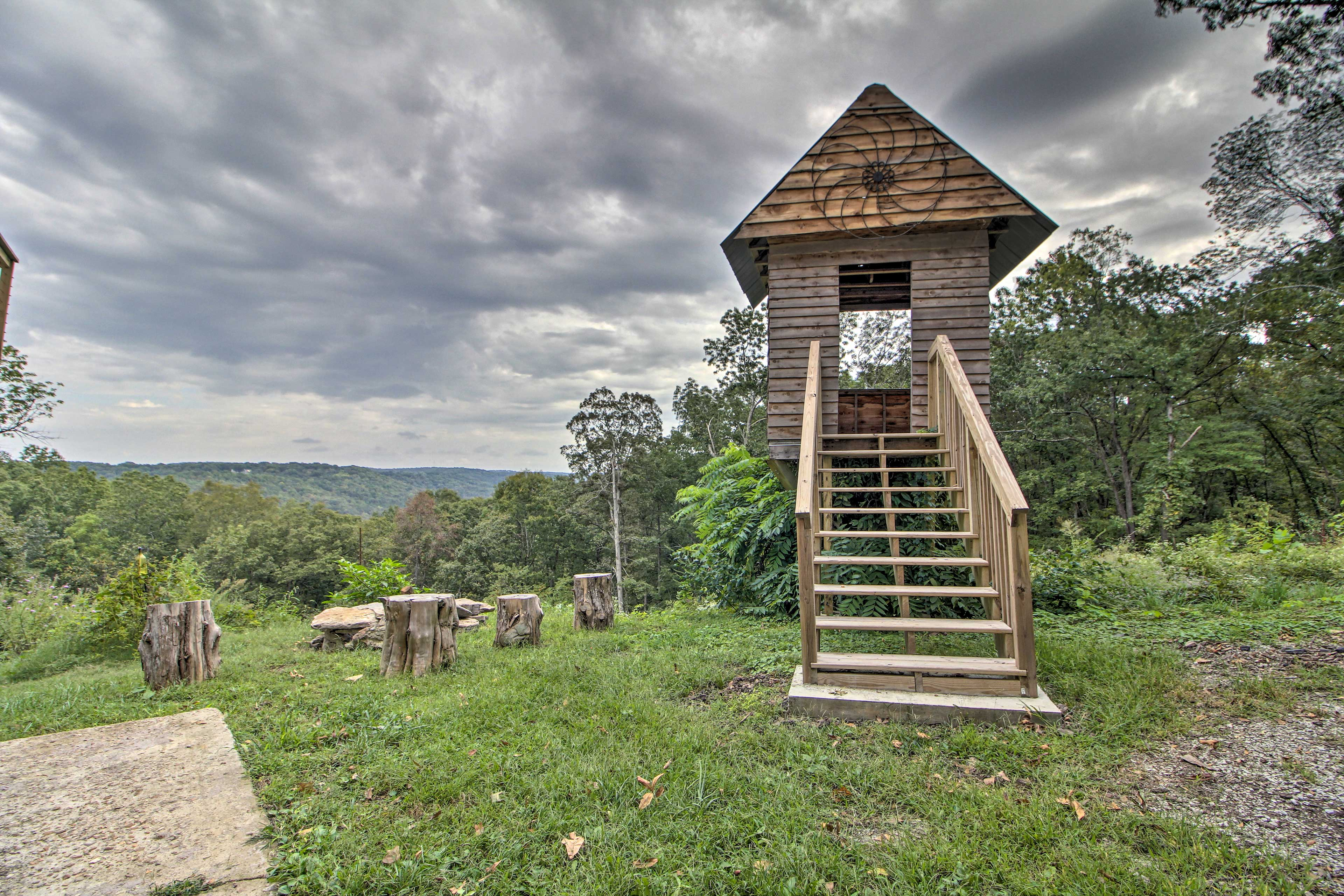 Explore the tree house on the property.
