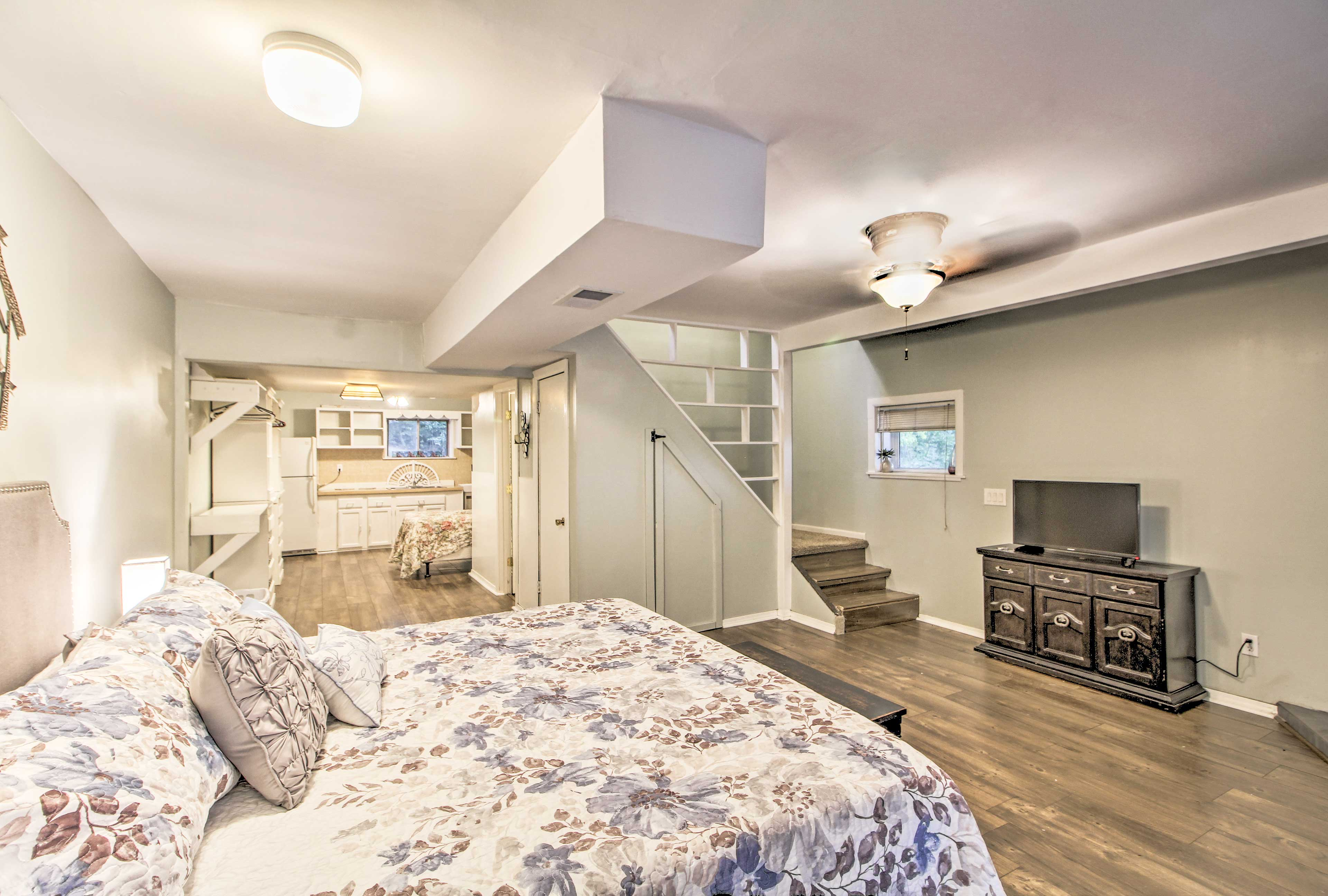 The master bedroom opens up into another kitchenette with a full bed.