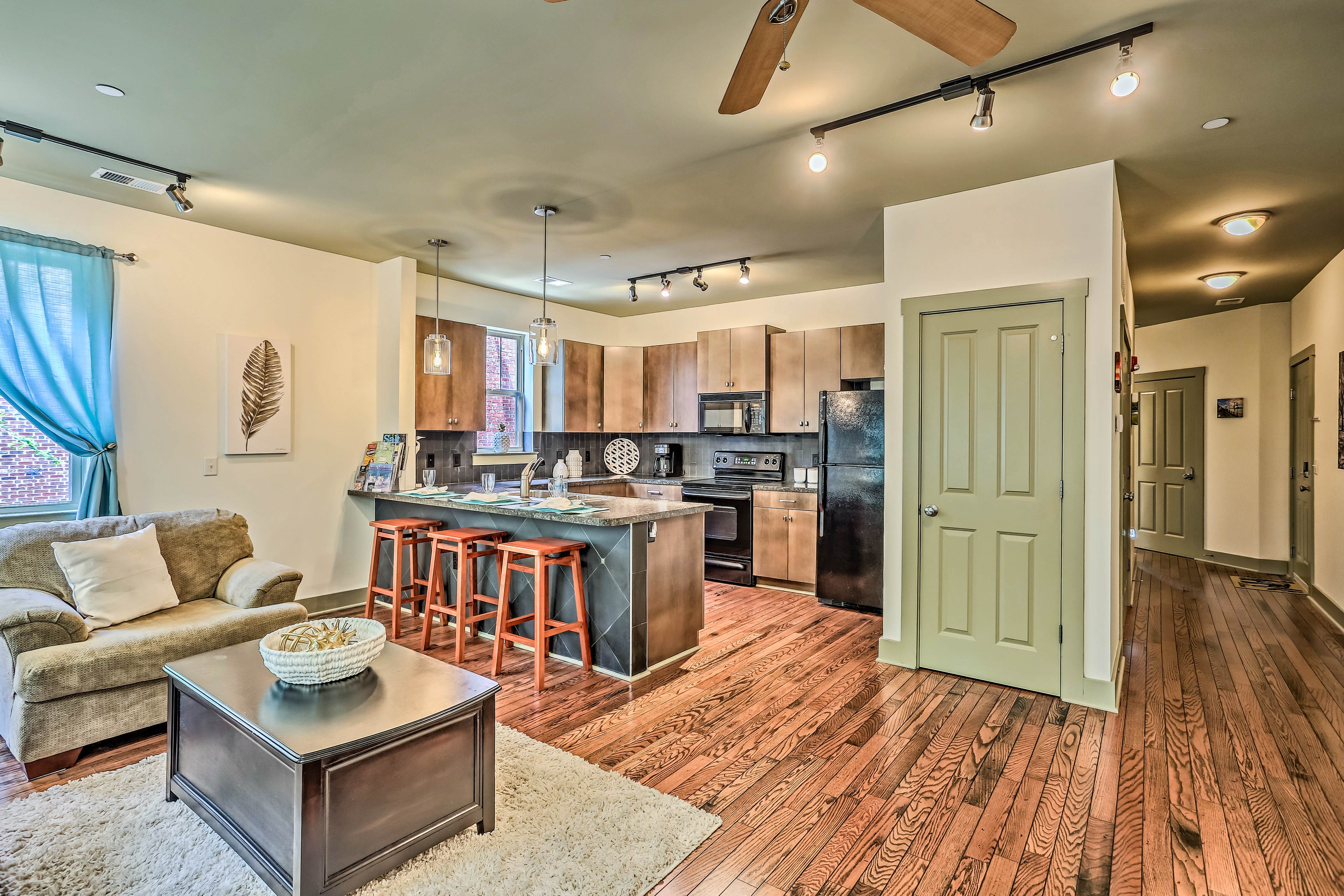 Hardwood floors lead throughout the cozy 1,000-square-foot unit.
