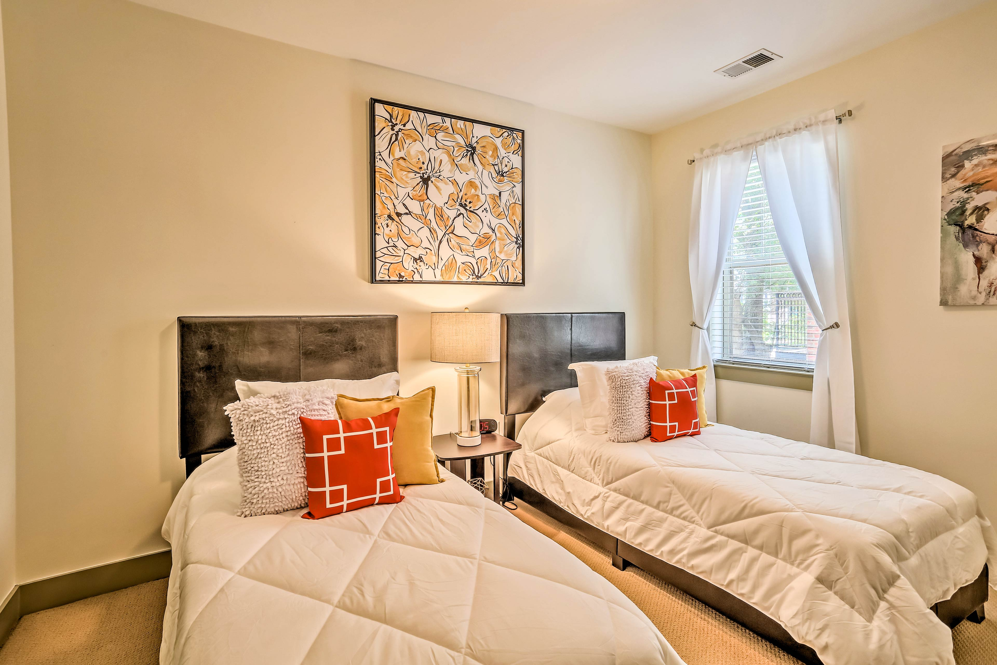The 2nd bedroom features 2 twin beds.
