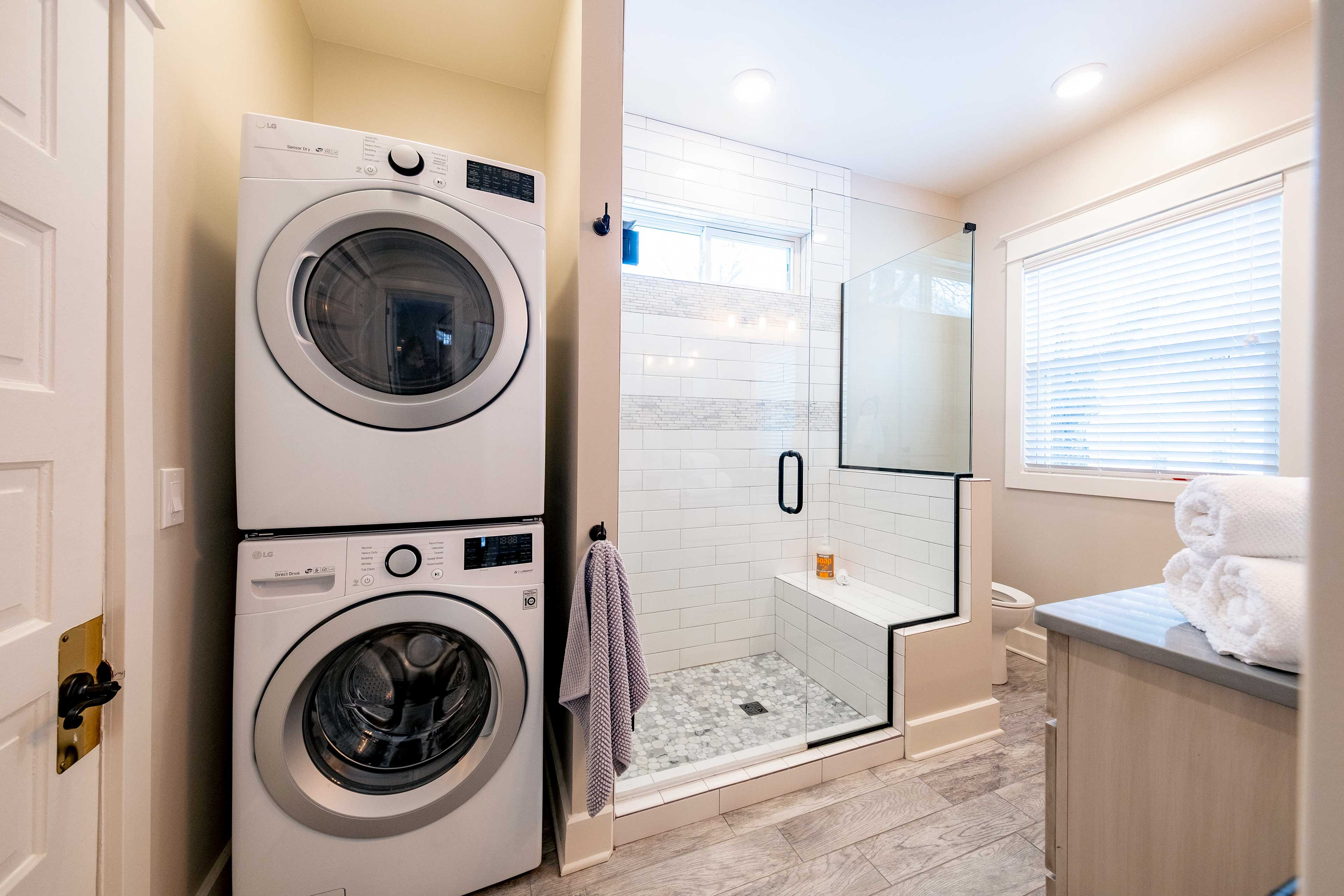 Full Bathroom | Stacked Laundry Machines