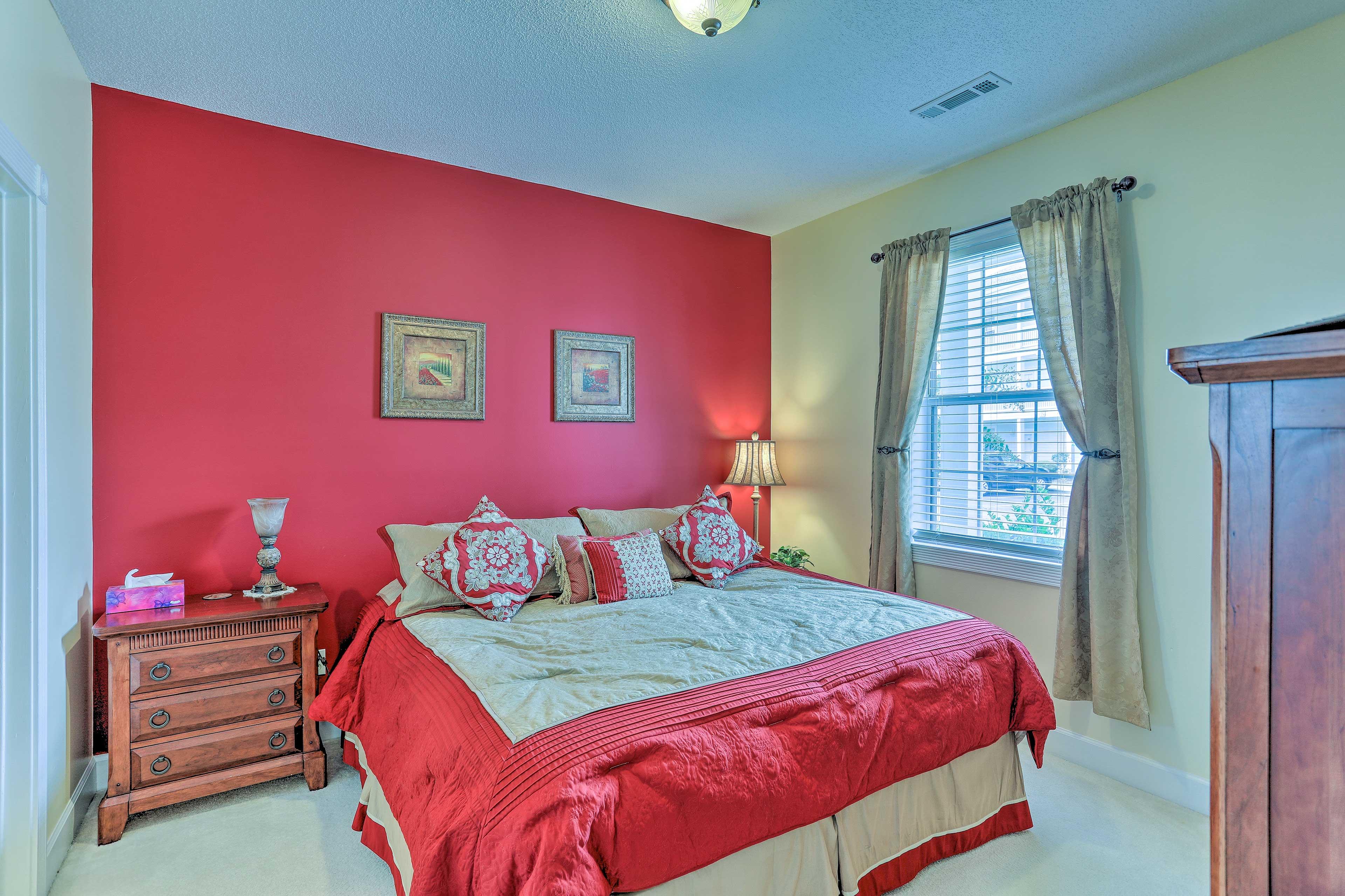 The second bedroom sleeps 2 on a queen bed.
