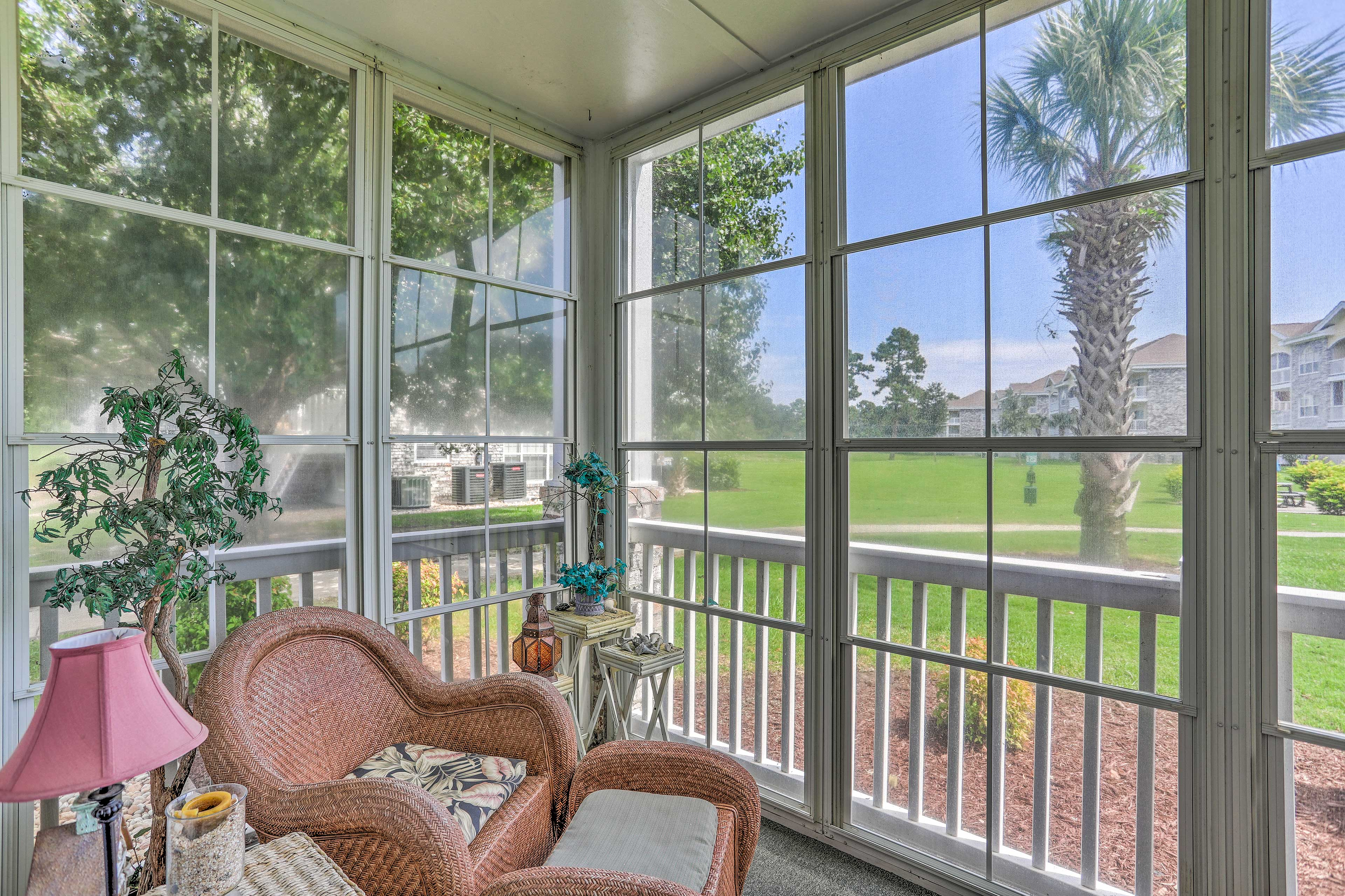 The screened-in porch is comfortably furnished.