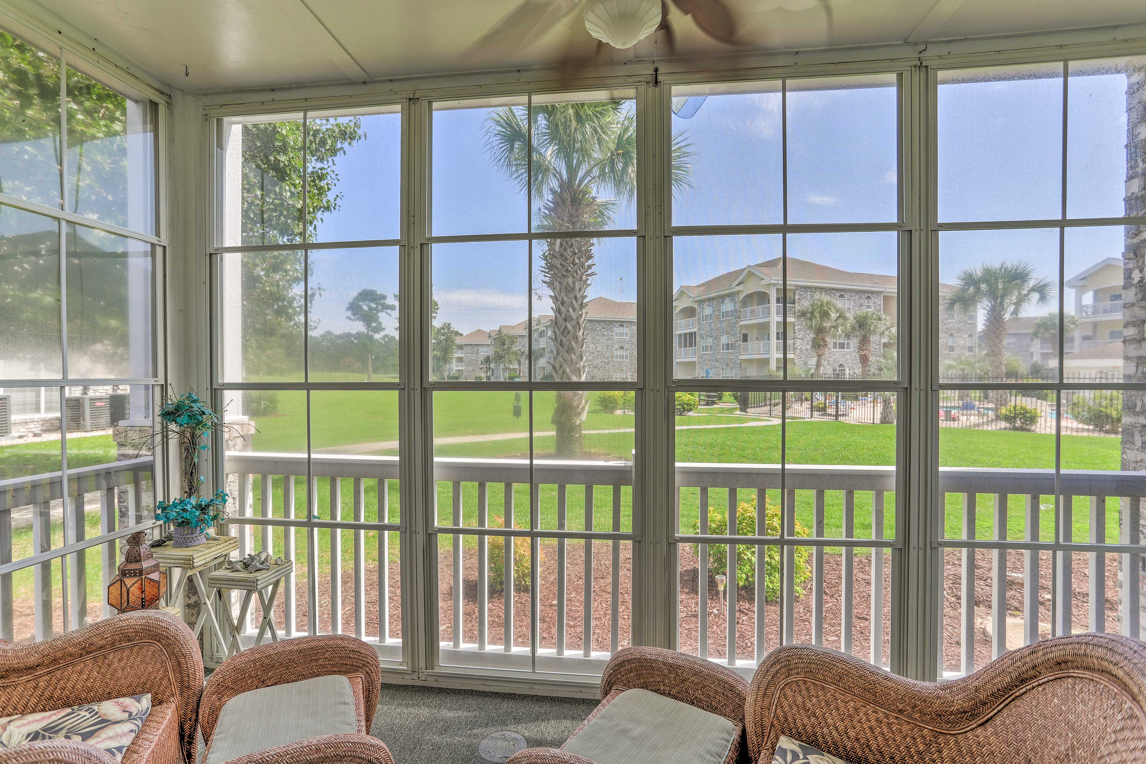 You'll have views of the pool from the comfort of the porch.