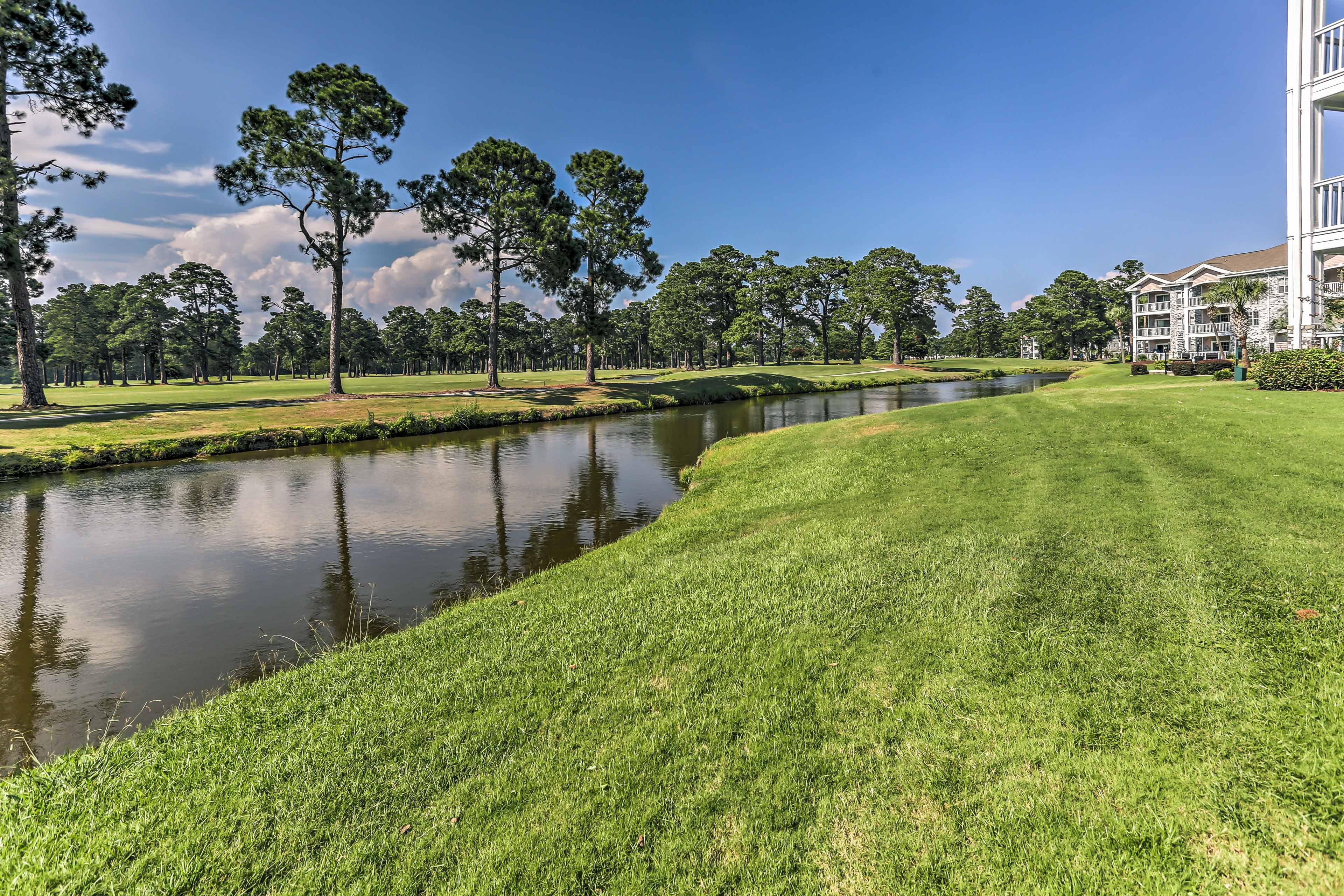 The community is situated across from a golf course.