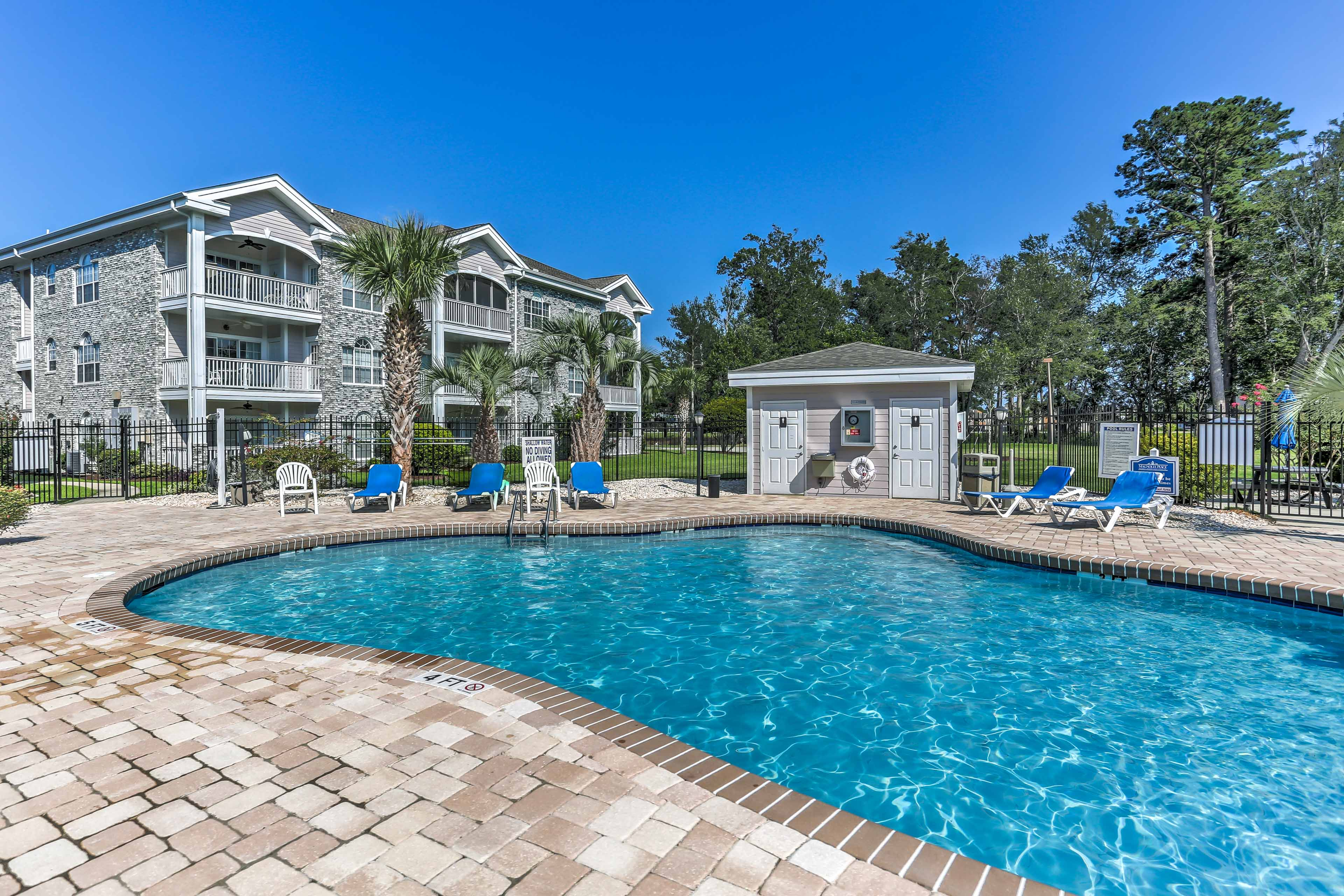 The 2-bedroom, 2-bath unit affords access to a lovely pool.