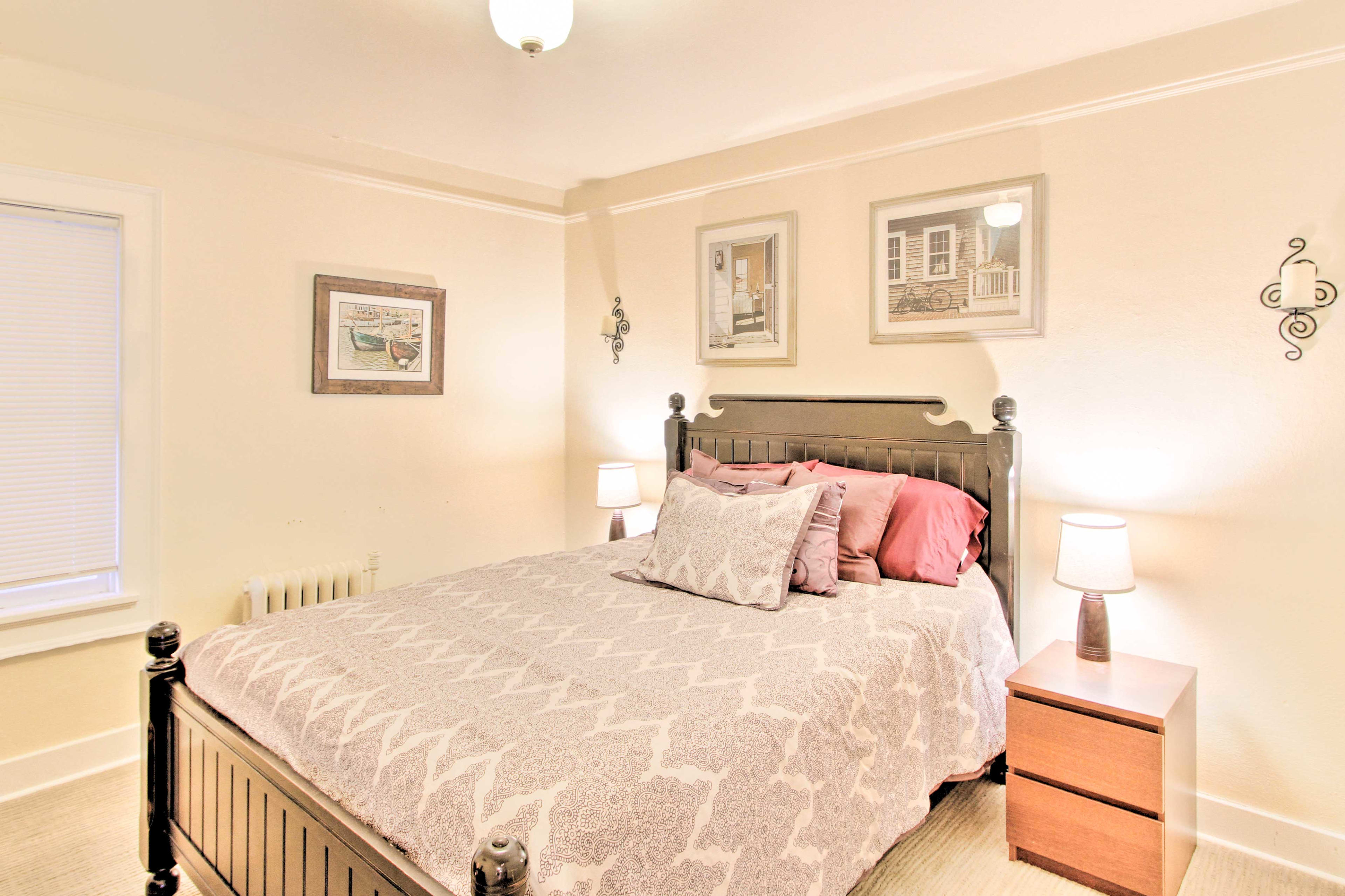 Two travelers can share the comfort of this queen bed.