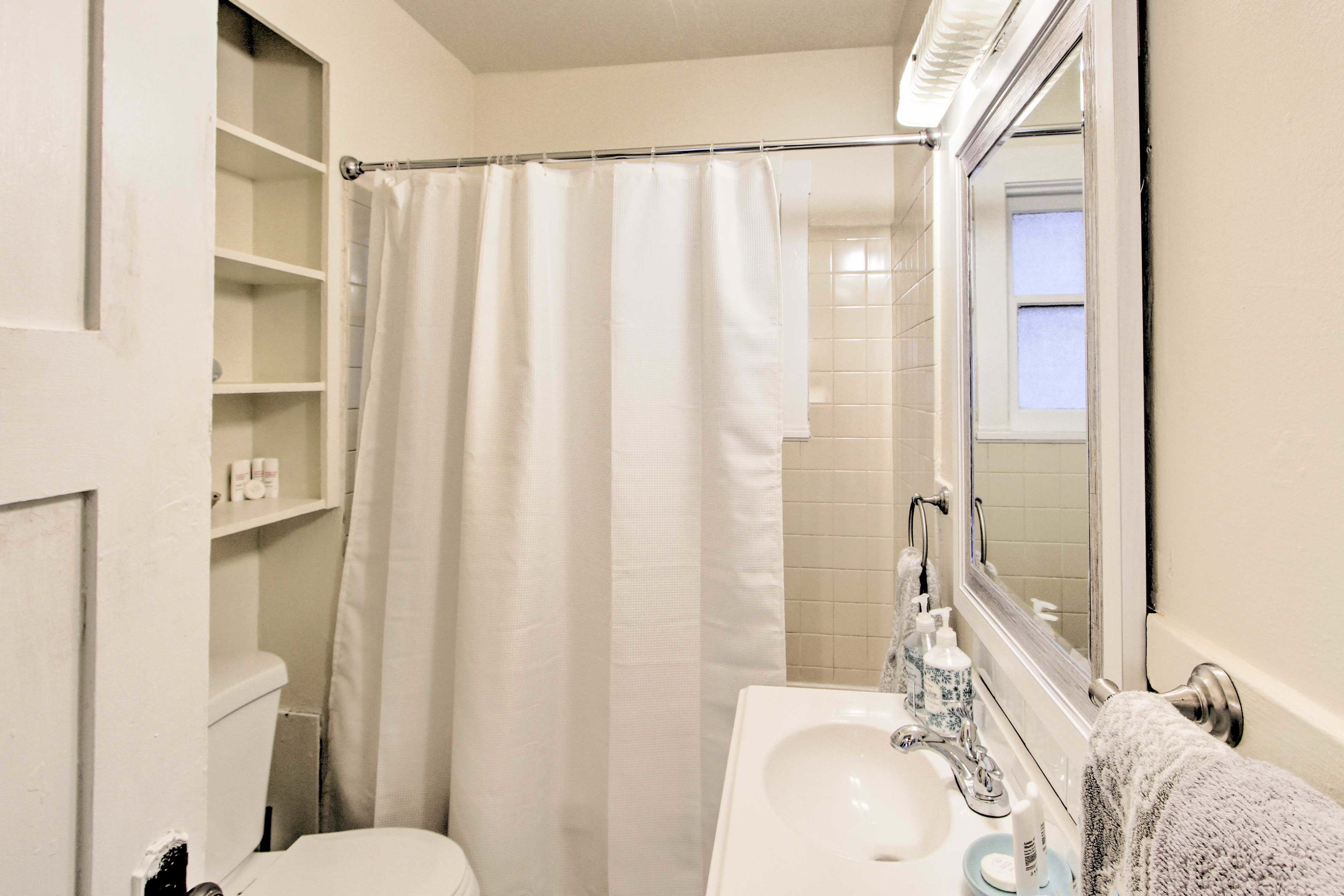 Towels, linens, and complimentary toiletries are provided.