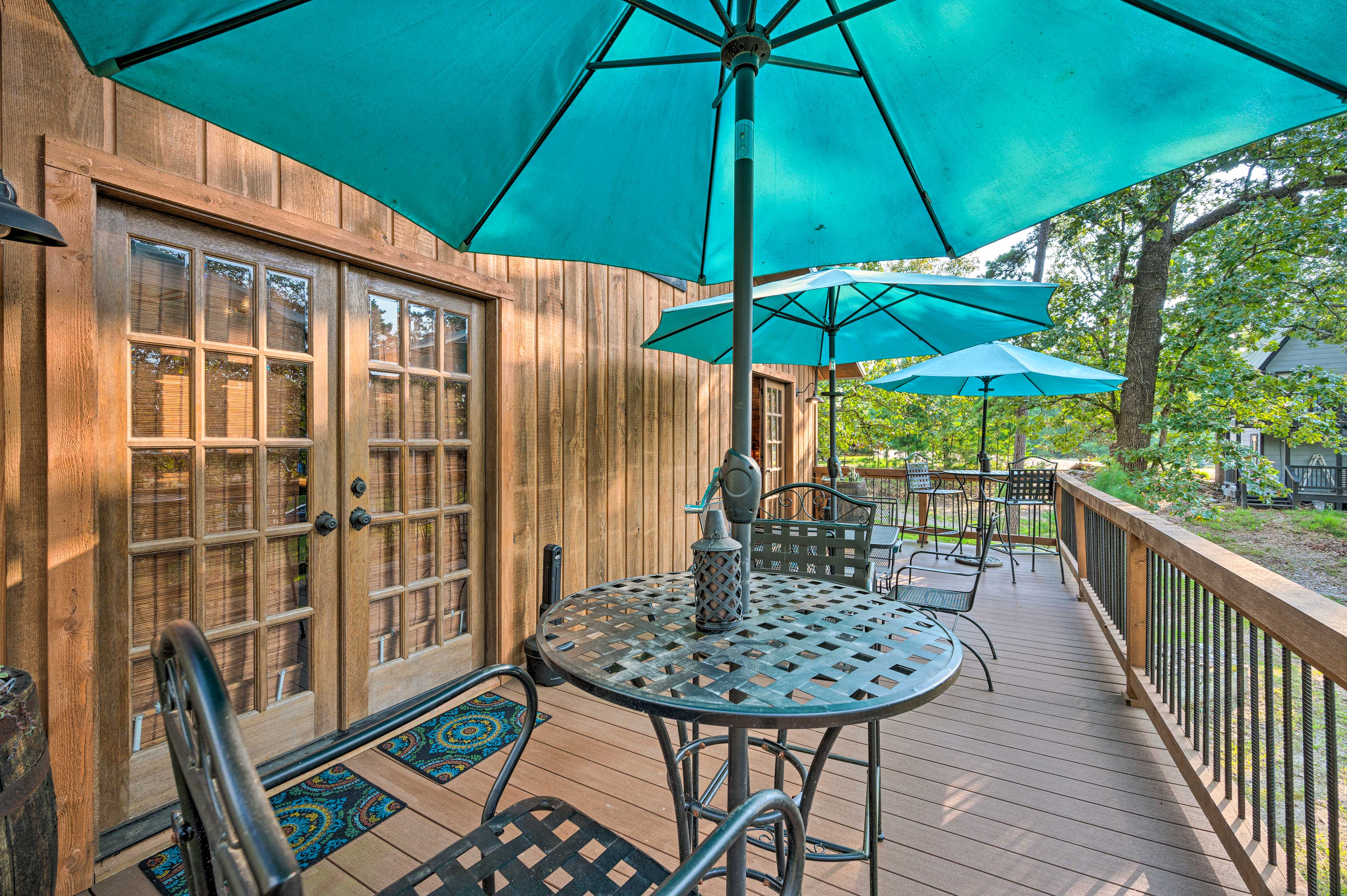 The deck has plenty of places to dine outside.