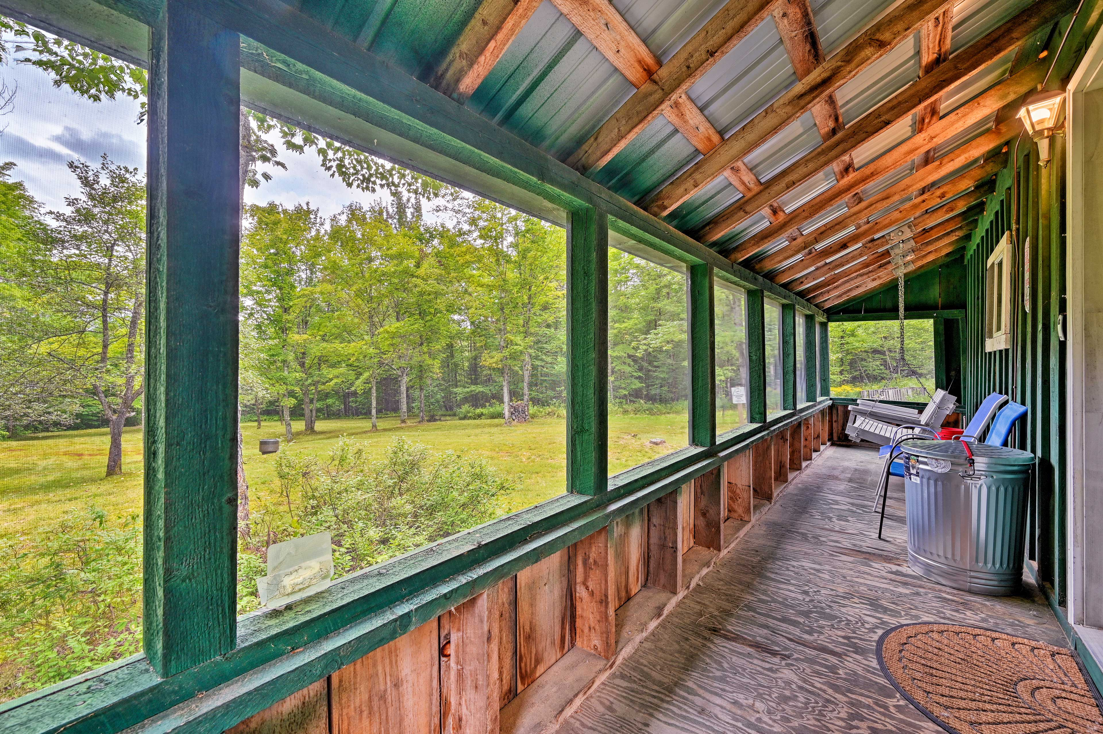 Take it easy in the comfort of the screened-in porch.