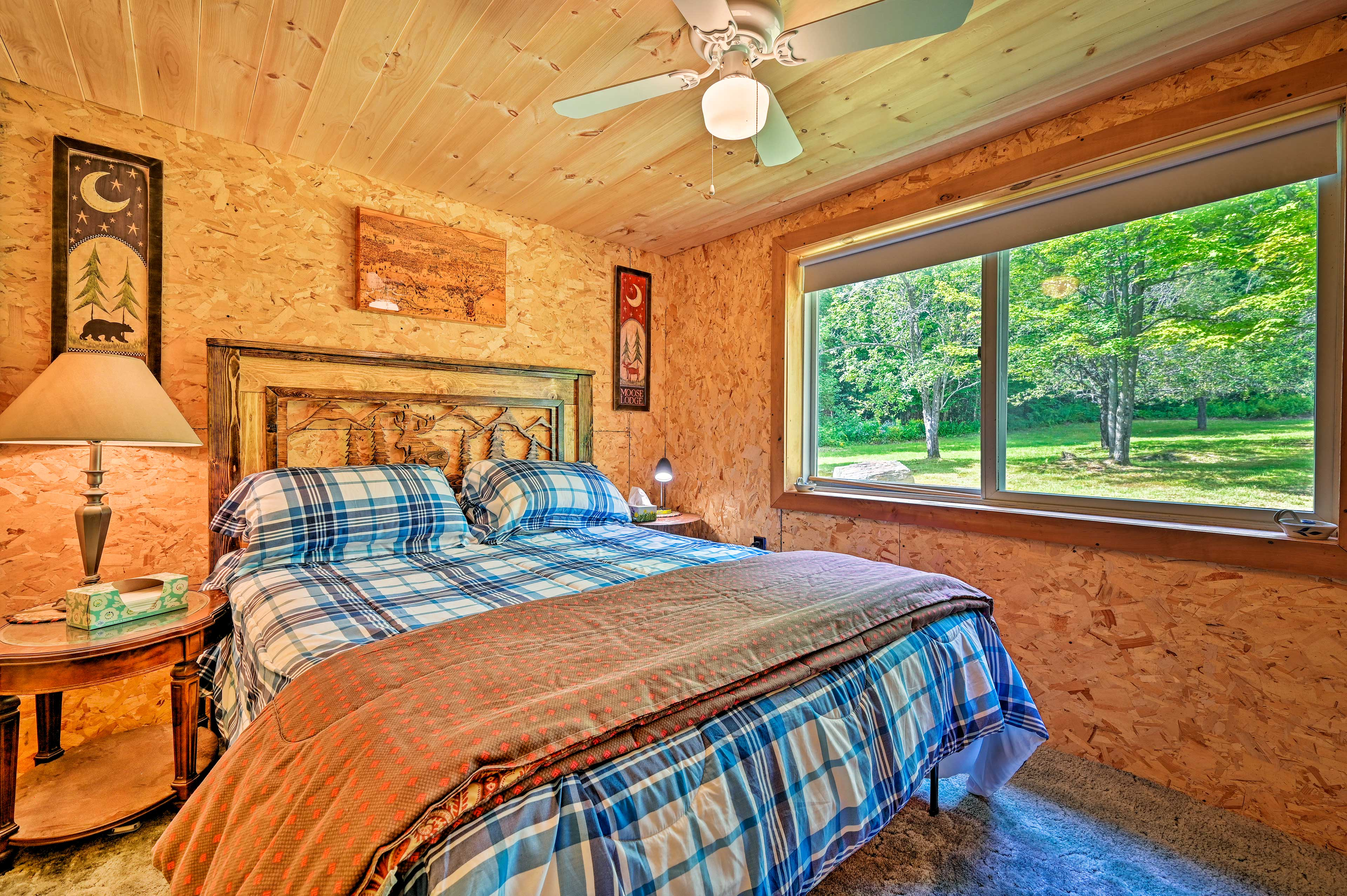 The bedroom boasts a queen bed beside the picture window.