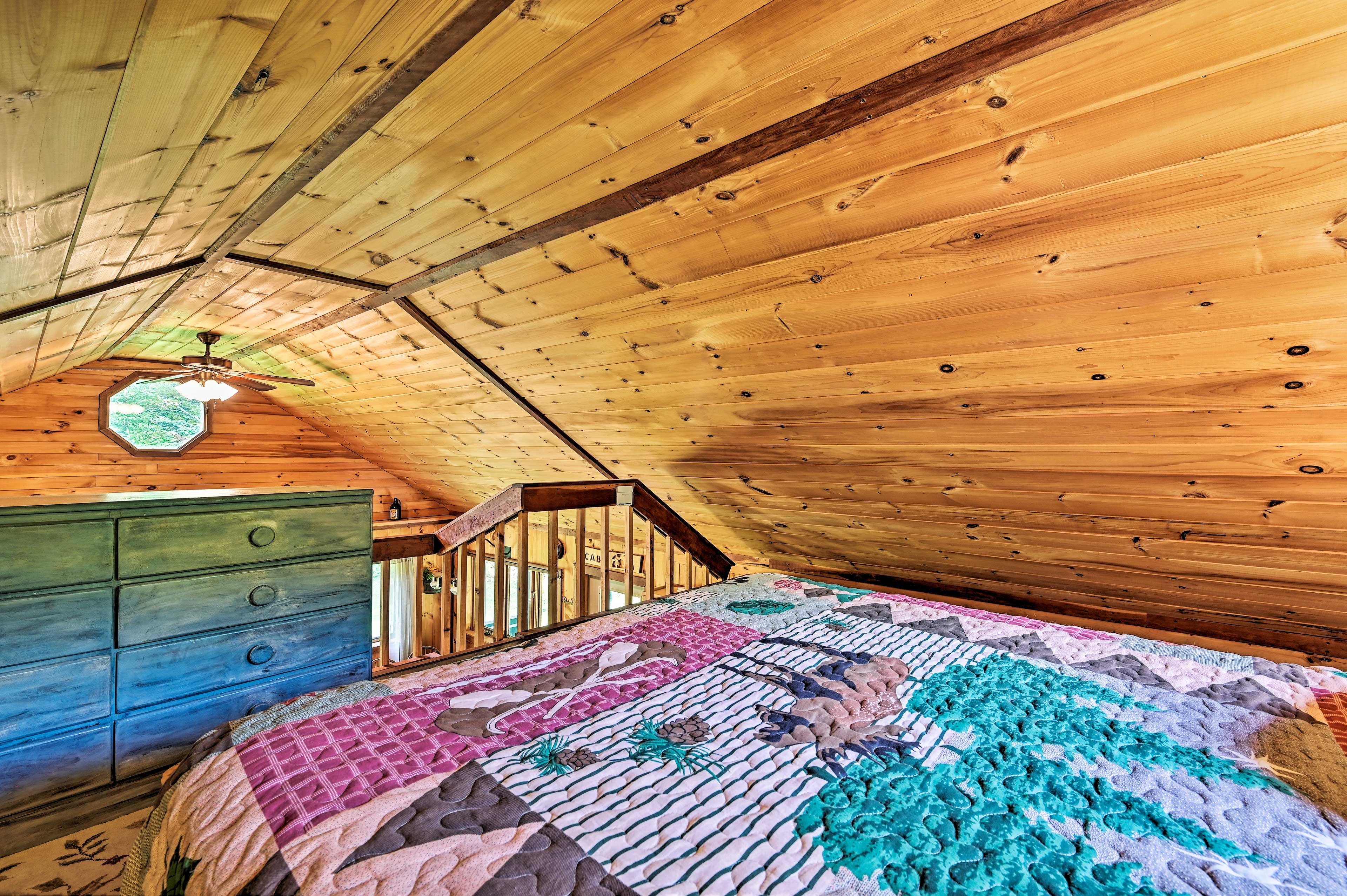 Head upstairs to the loft, where you'll find another queen bed.