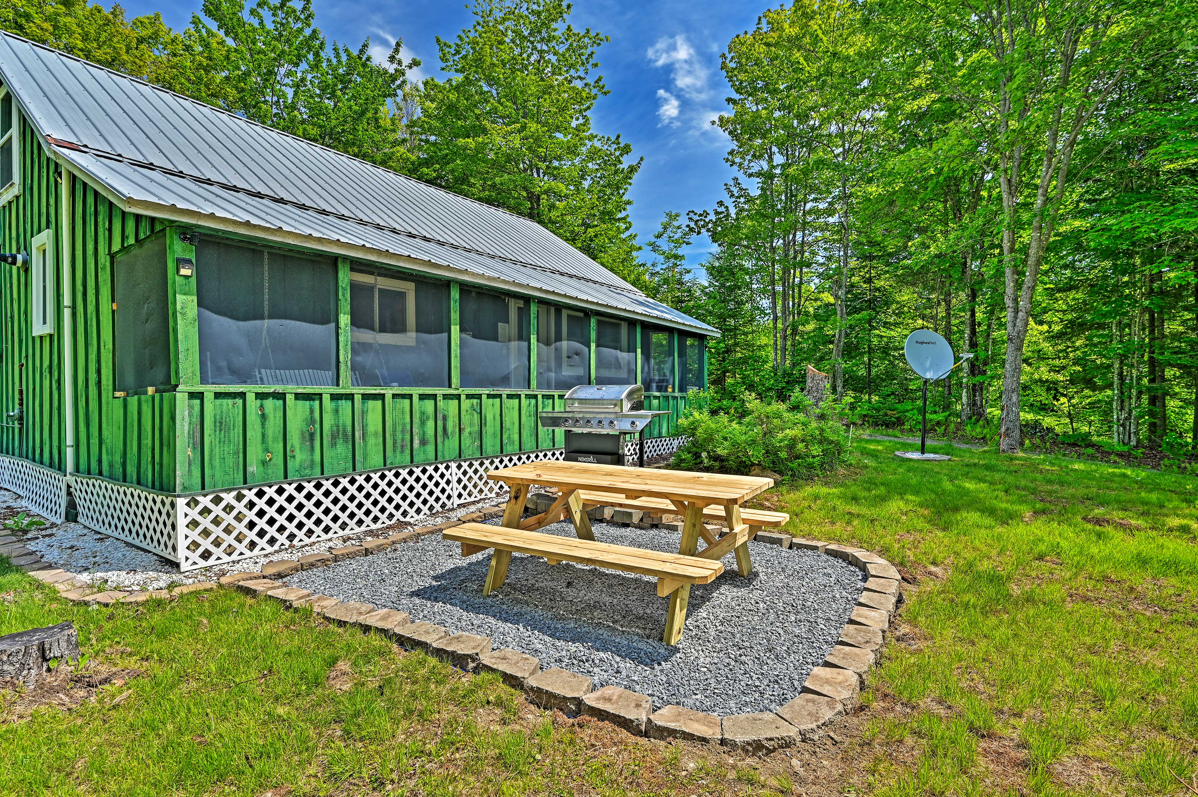 Dine al fresco at the picnic table beside the cabin.