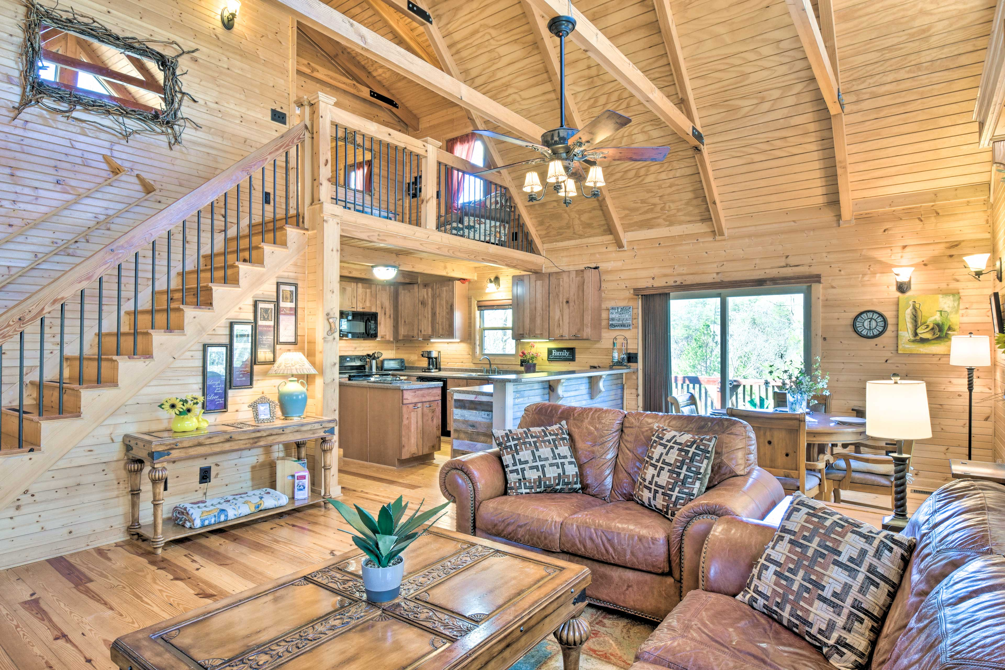Relax in this comfy living area featuring a flat-screen cable TV & fireplace.