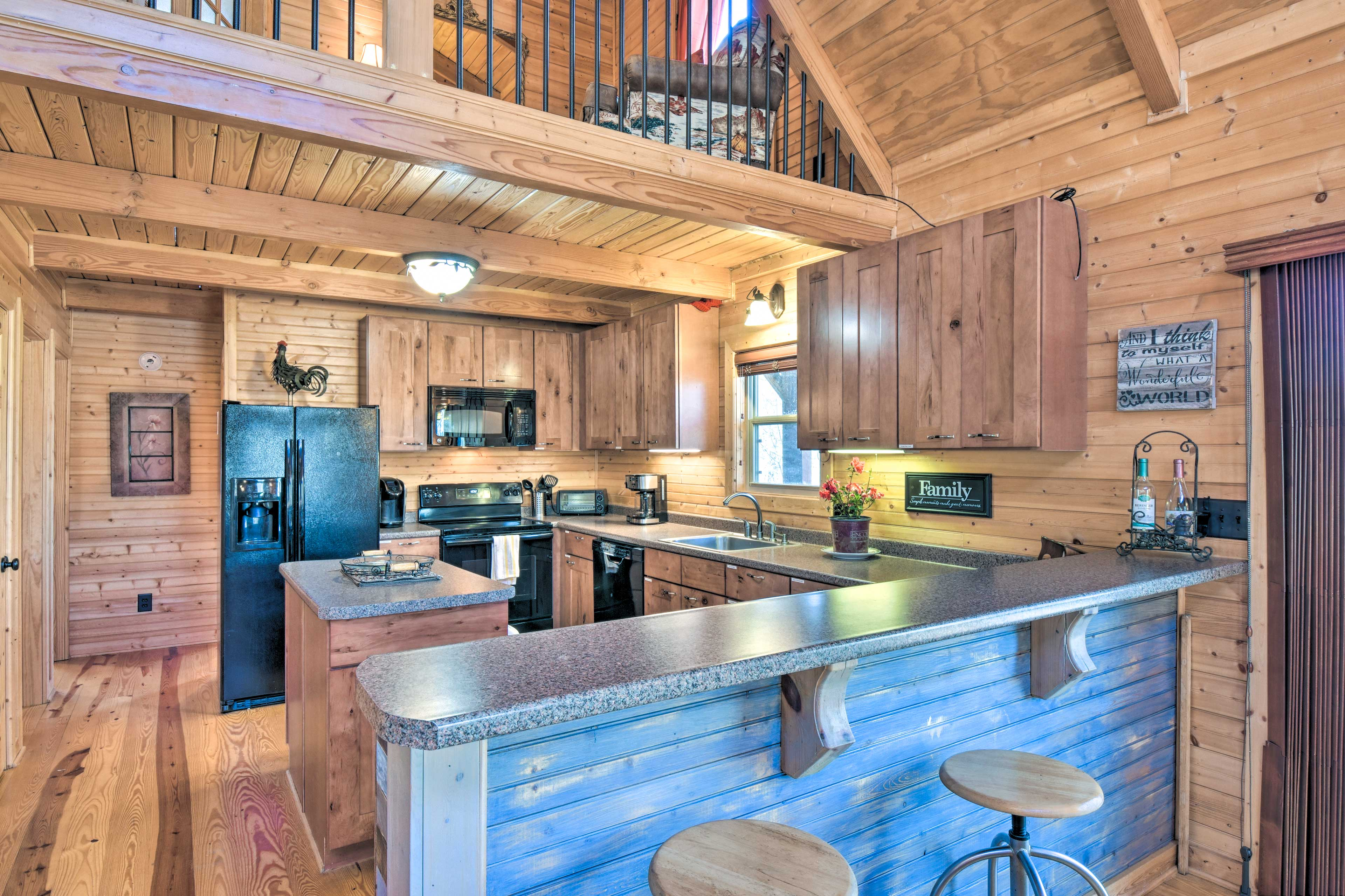 This kitchen boasts a center island and ample space to whip up a meal.