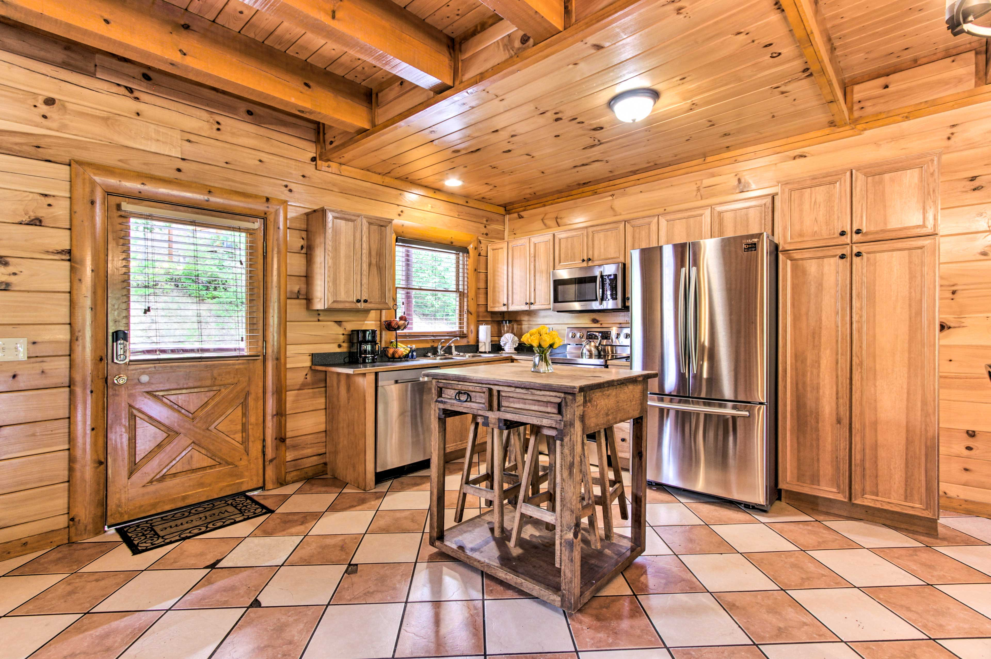 The rustic interior of the cabin makes for a warm and inviting stay.