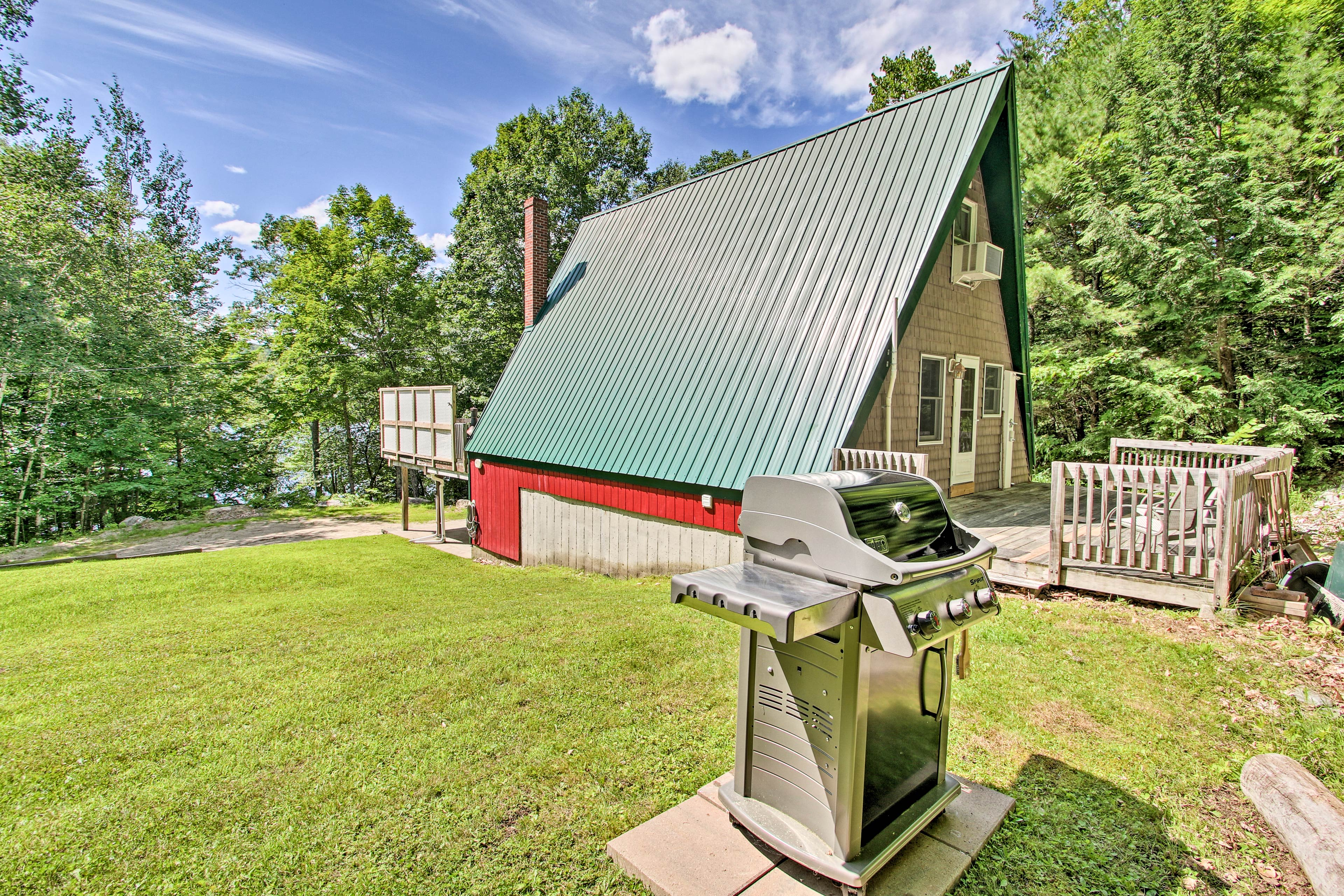 This lakefront home features a grill, fire pit, hot tub, kayaks, and more!