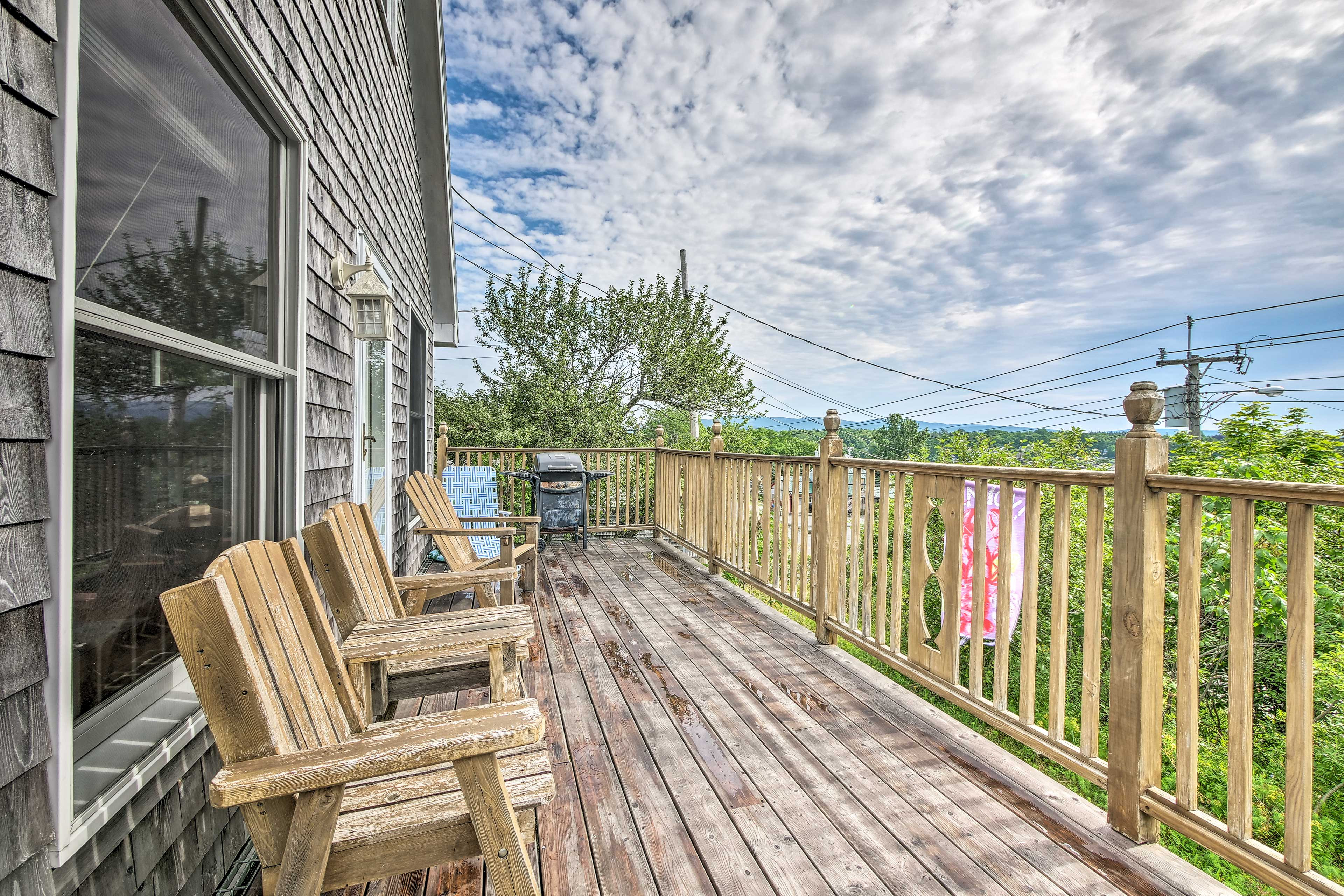 Spend time enjoying the simpler things on the deck of this vacation rental!