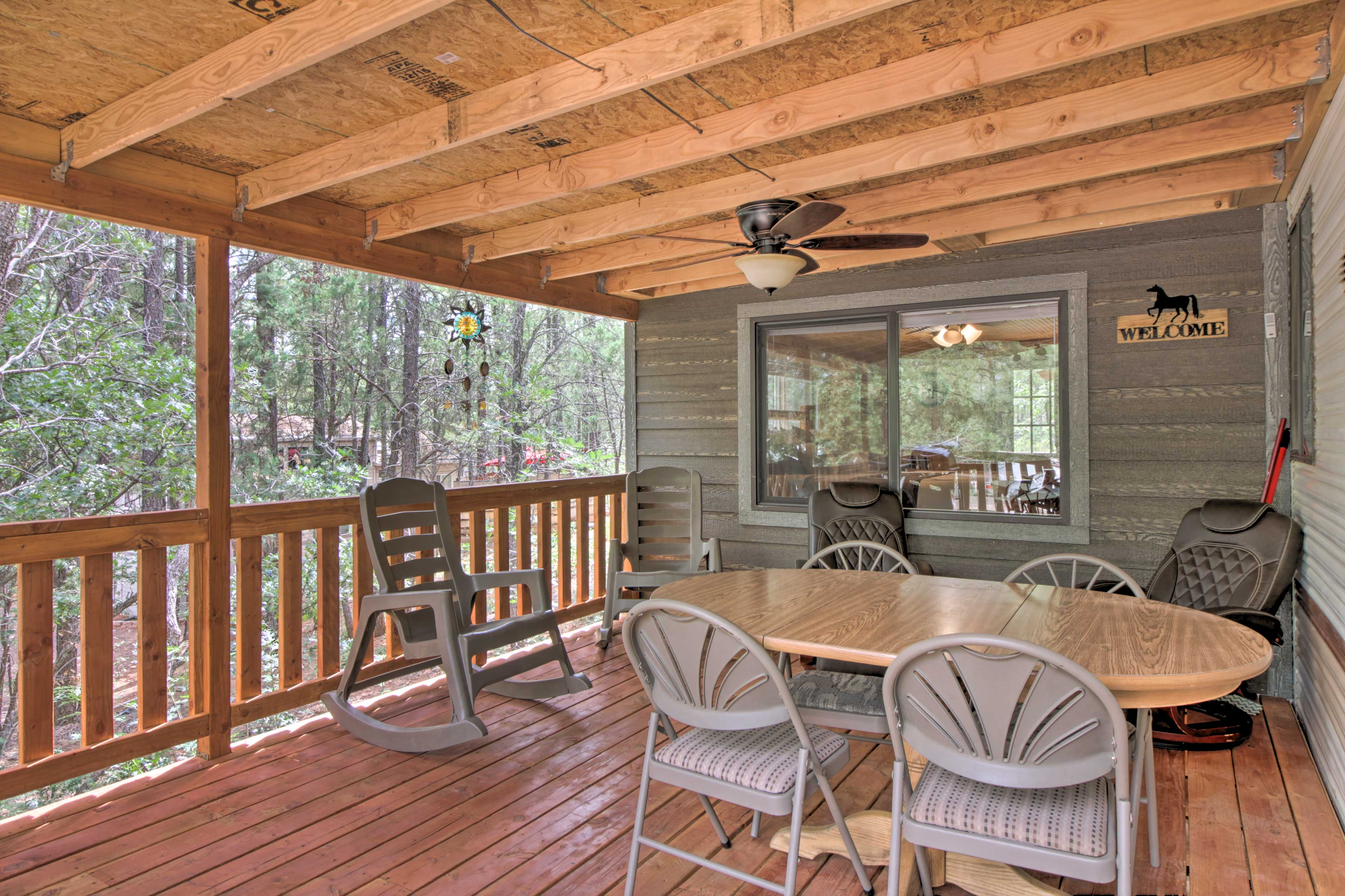 End each day on the vacation rental's covered deck, complete with a ceiling fan.