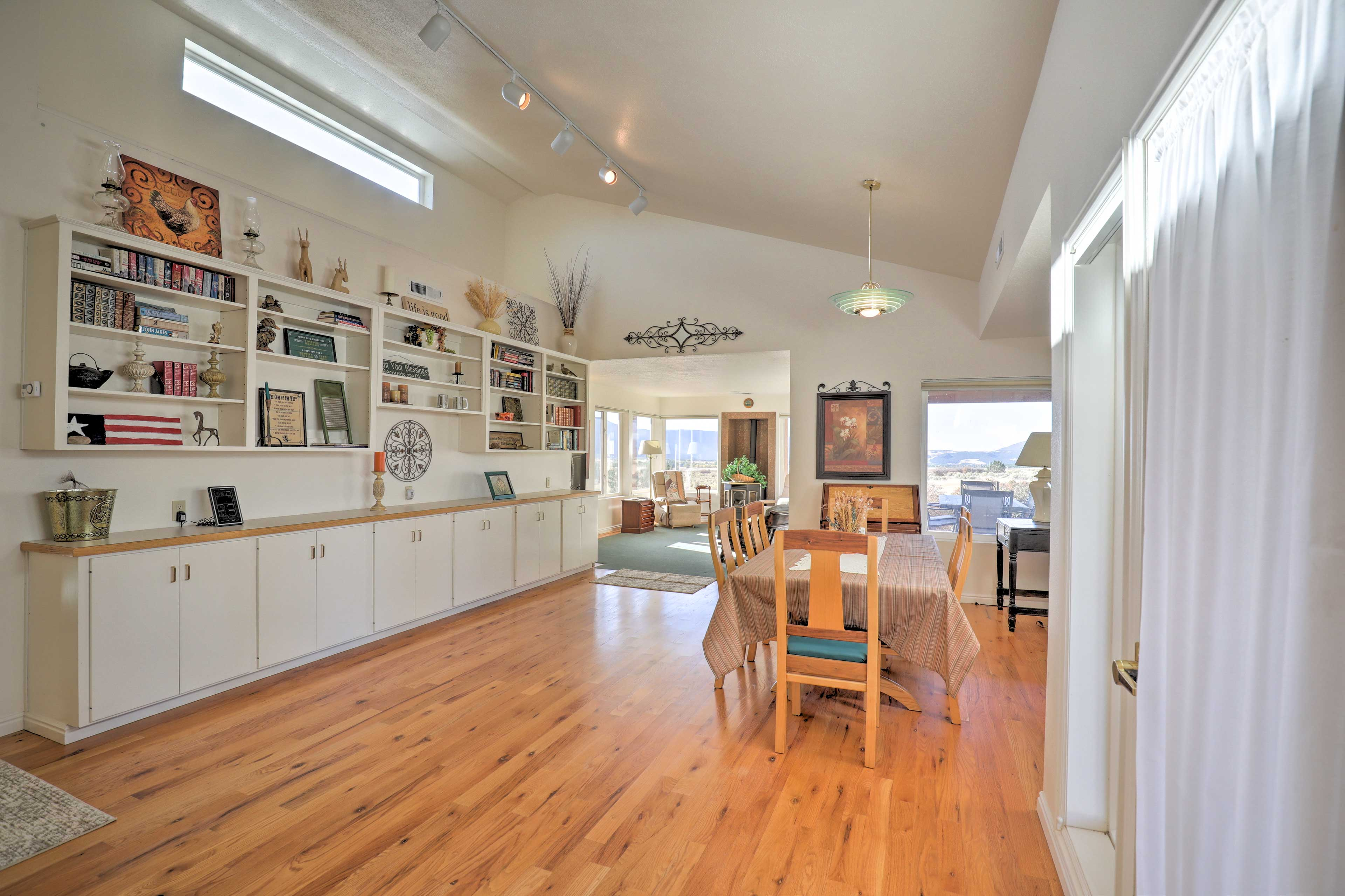 The spacious dining room is highlights by a custom bookshelf.