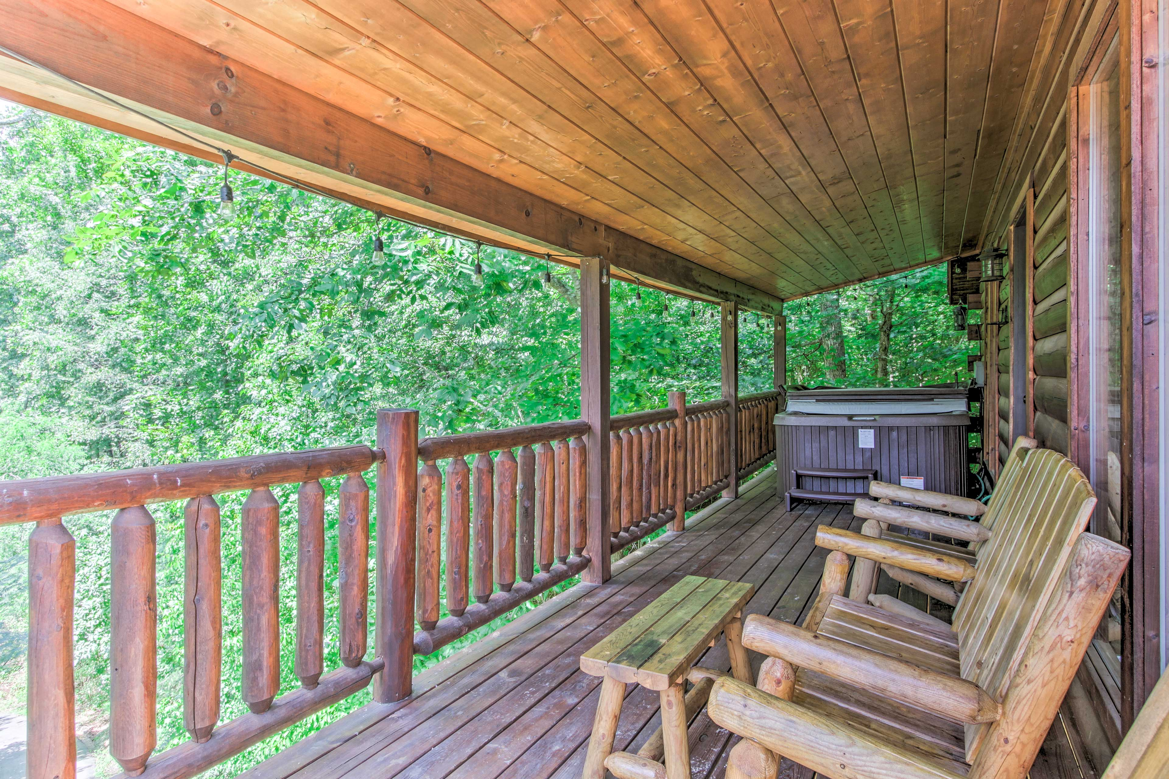 Head out to the deck to relax on the log chairs.