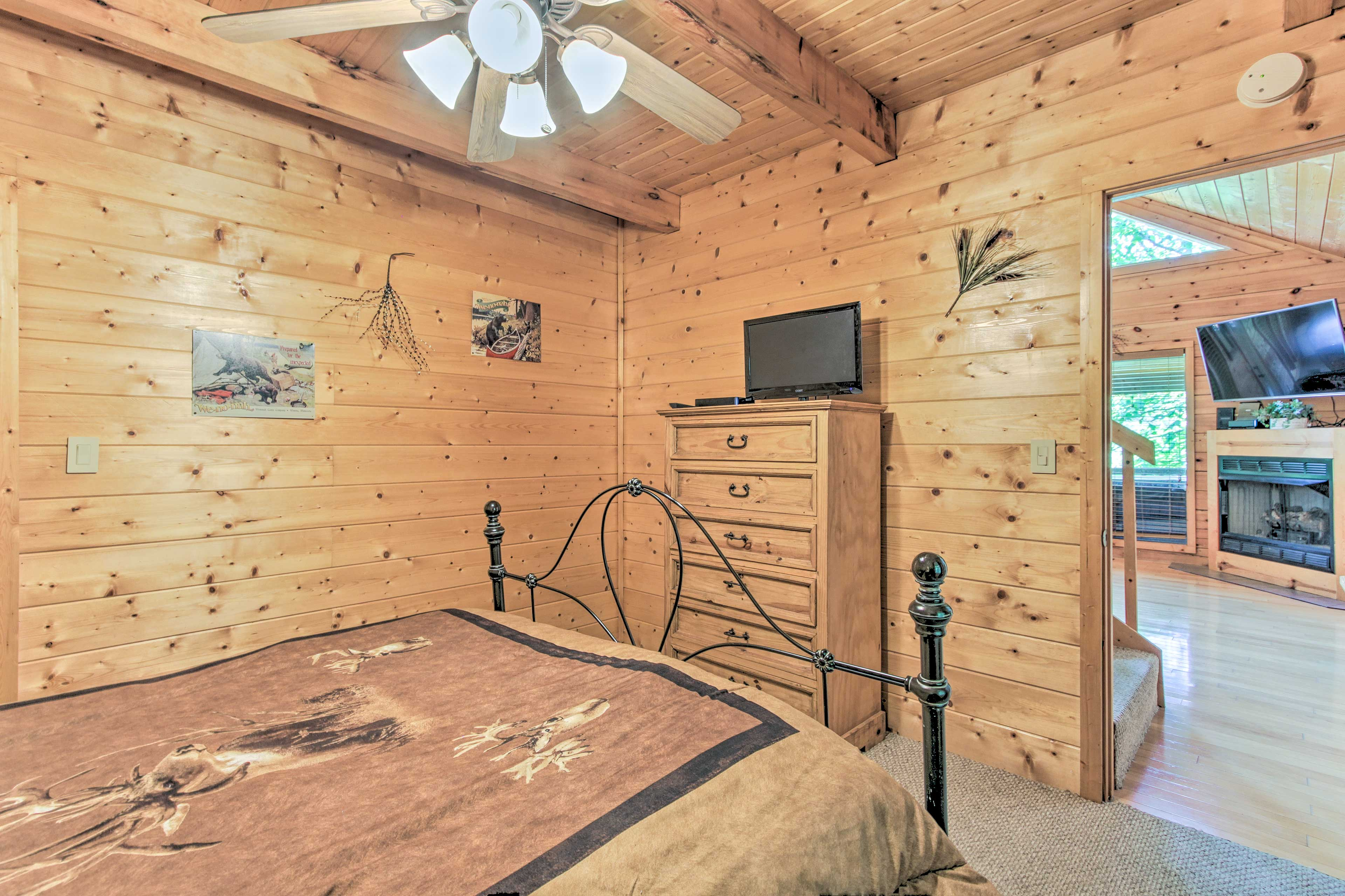 The bedrooms have been updated with log-style beds!
