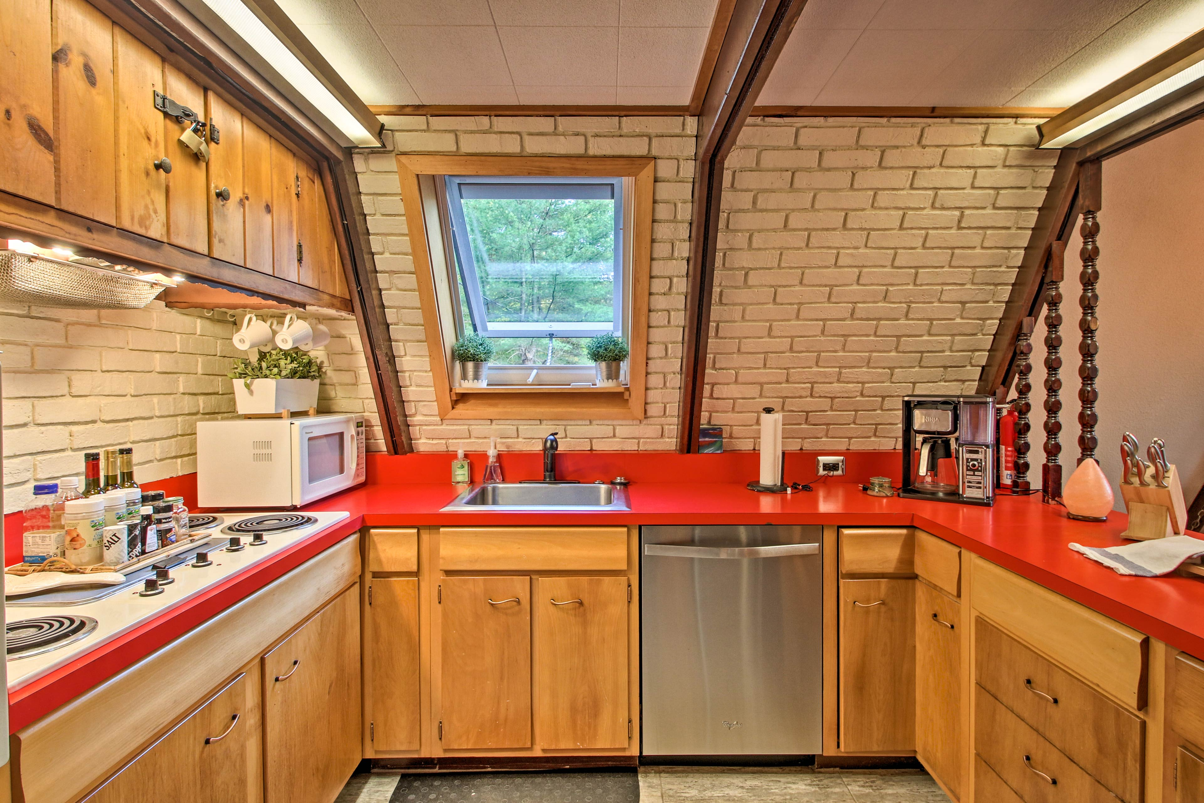The exposed brick gives the kitchen a charming touch.