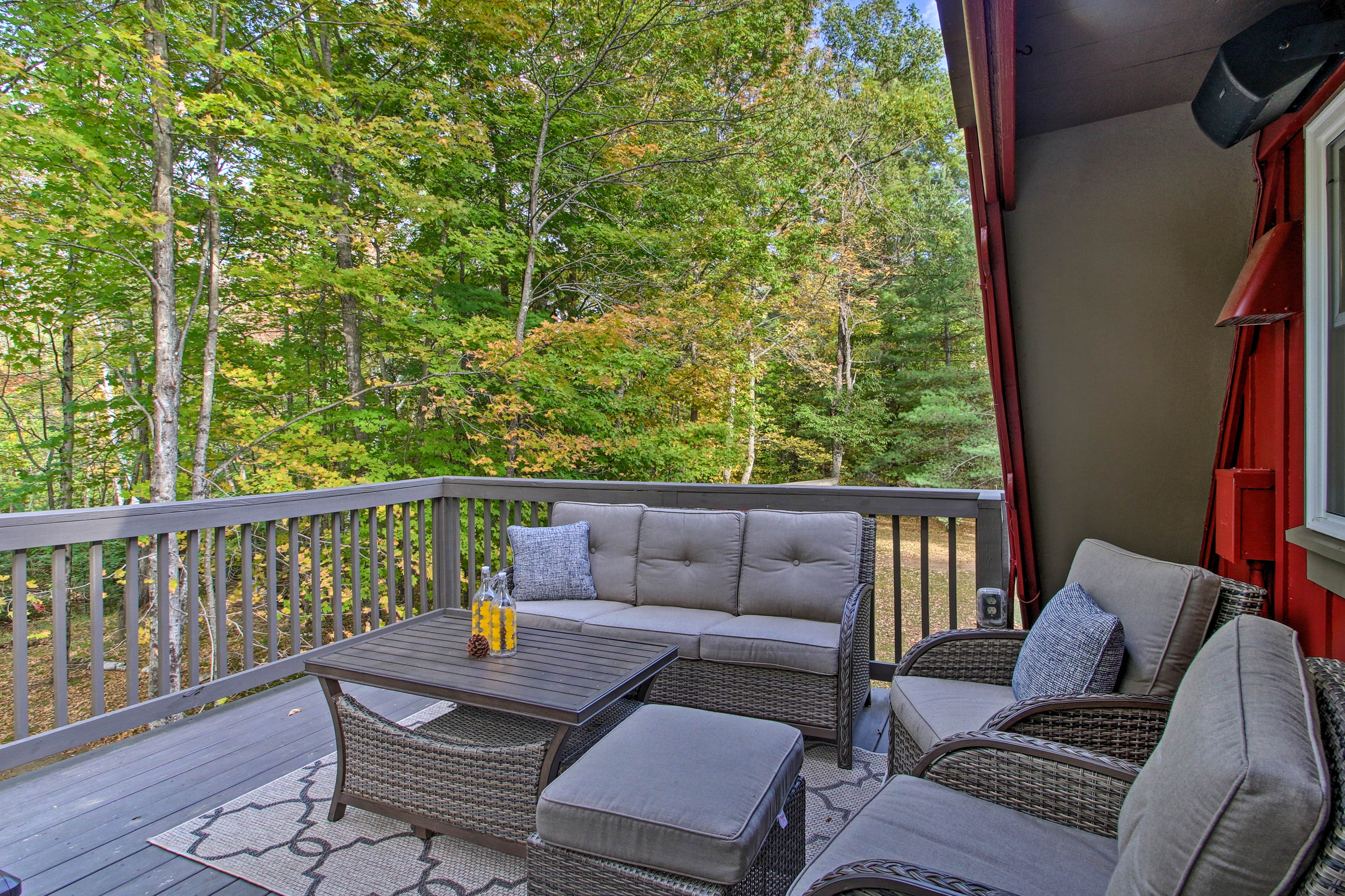 The balcony comes furnished with cushioned seating!