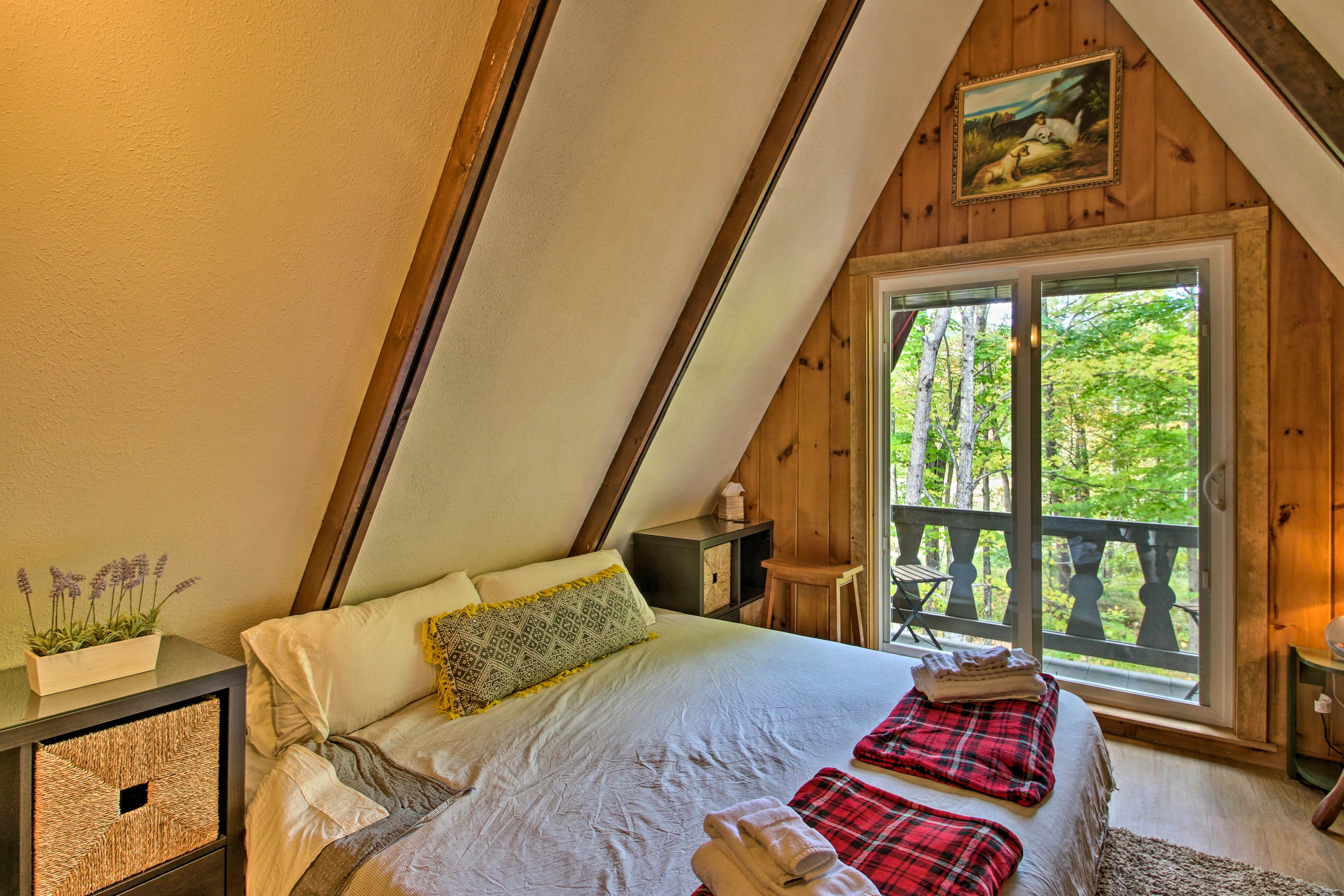 This bedroom offers a private balcony and a king-sized bed!