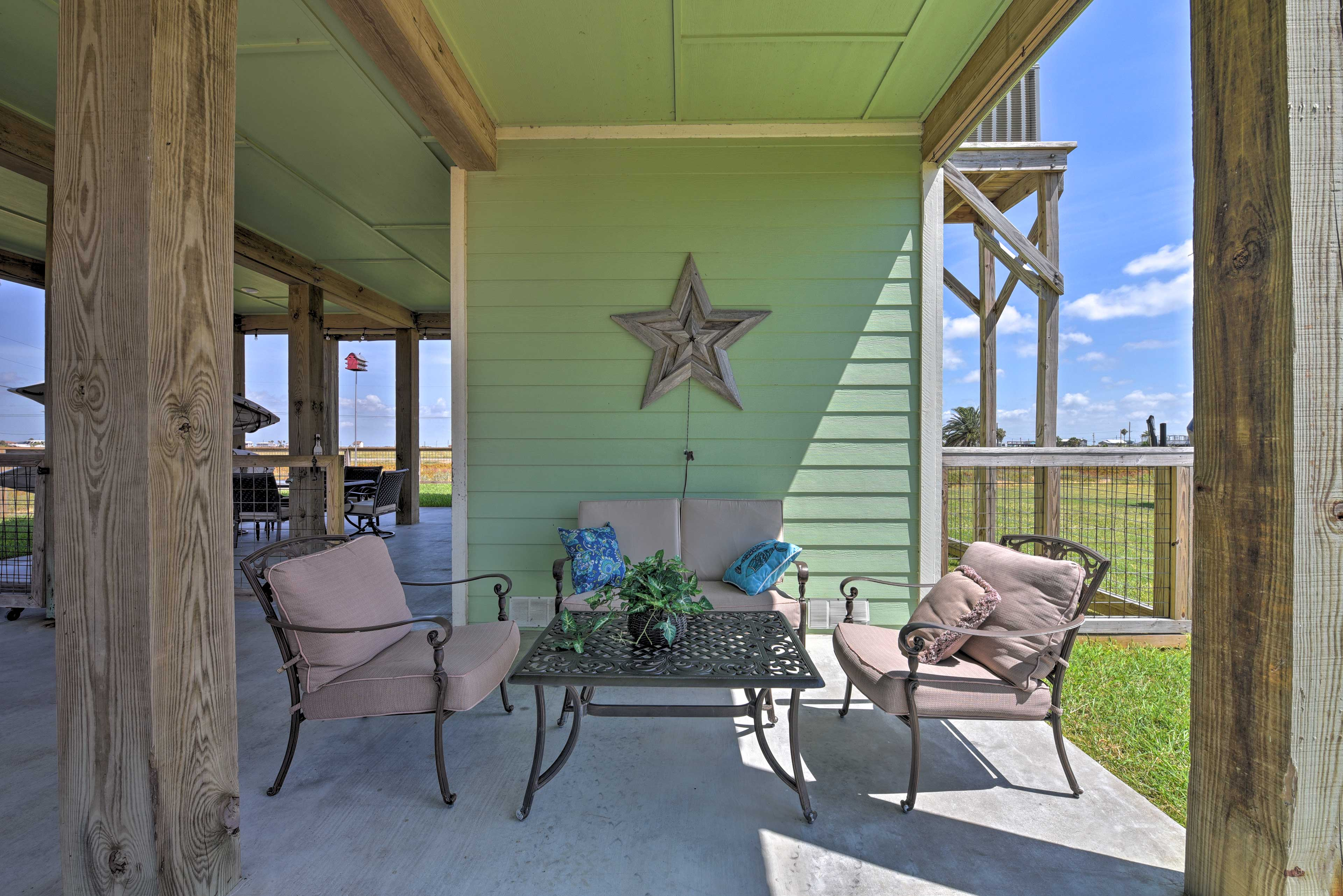 Enjoy time outdoors under this stilted home, a common style of the area.