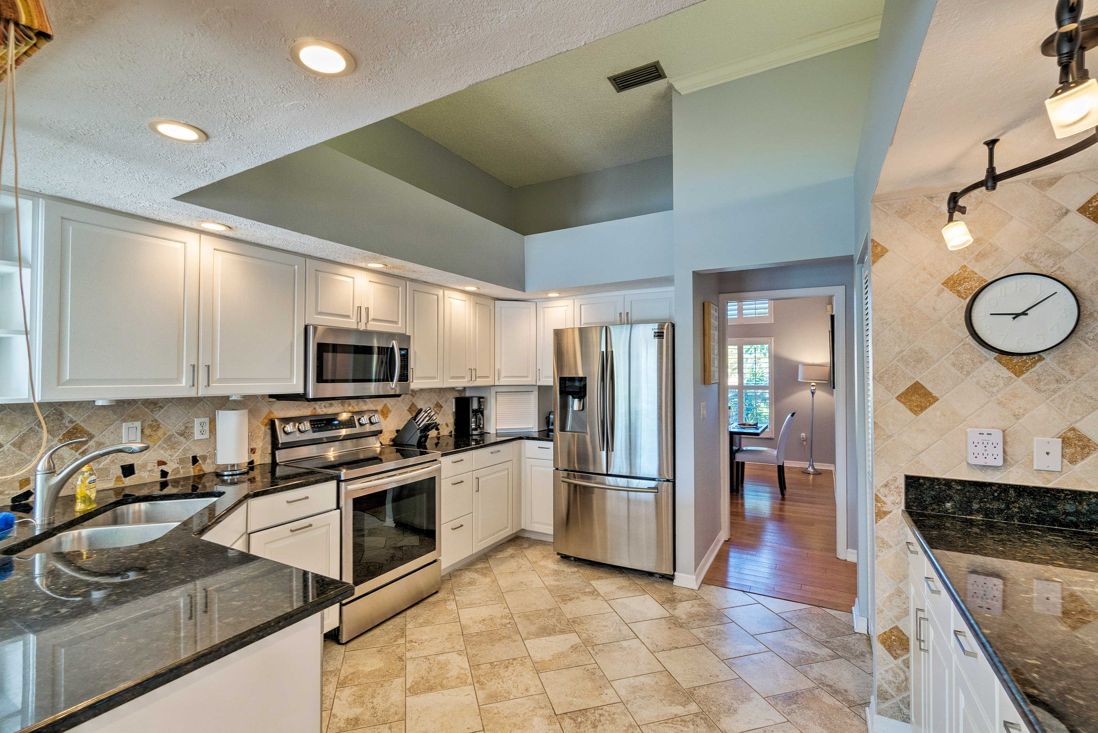 Granite countertops and stainless steel appliances elevate this kitchen.
