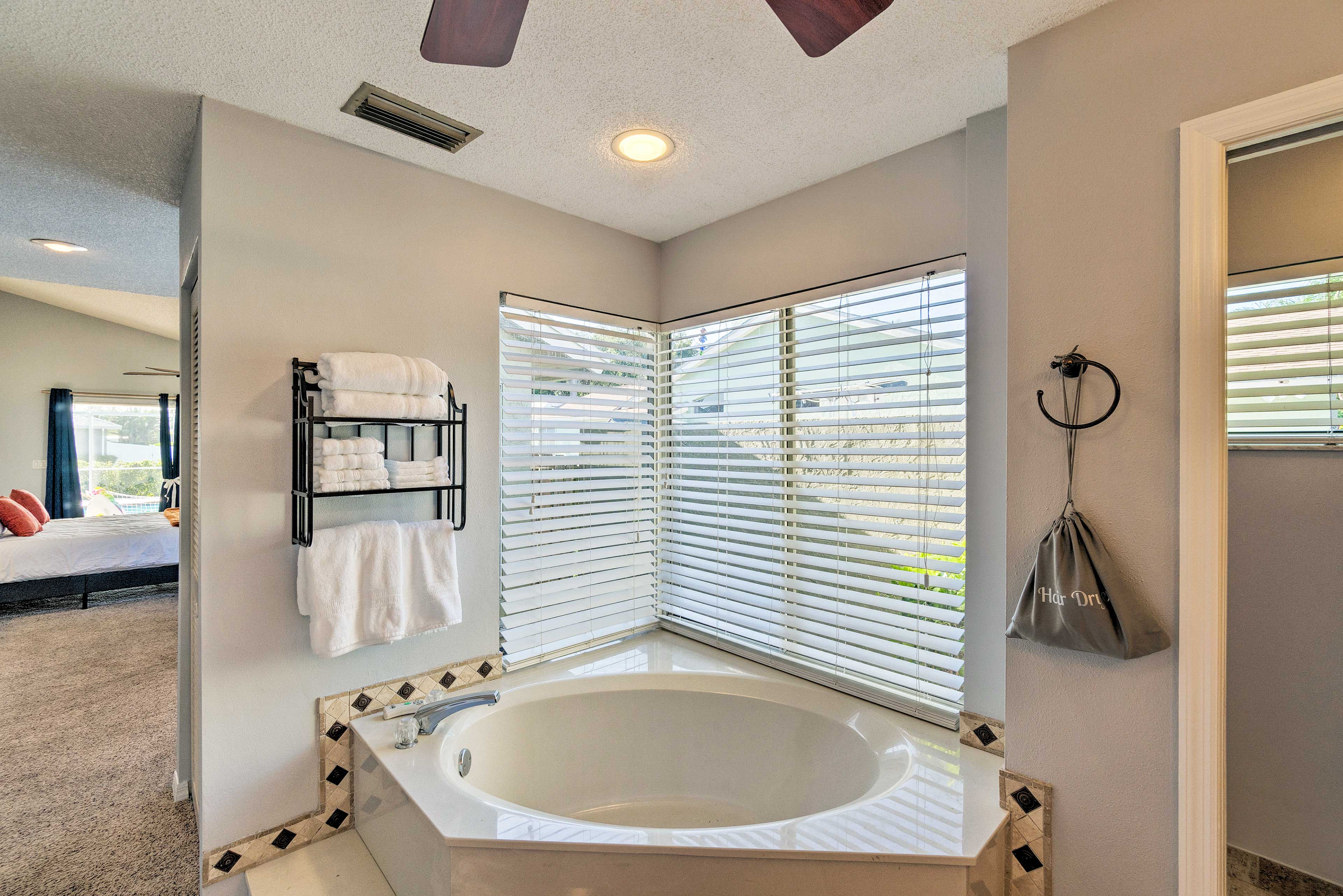 Enjoy a soothing soak in the garden tub.