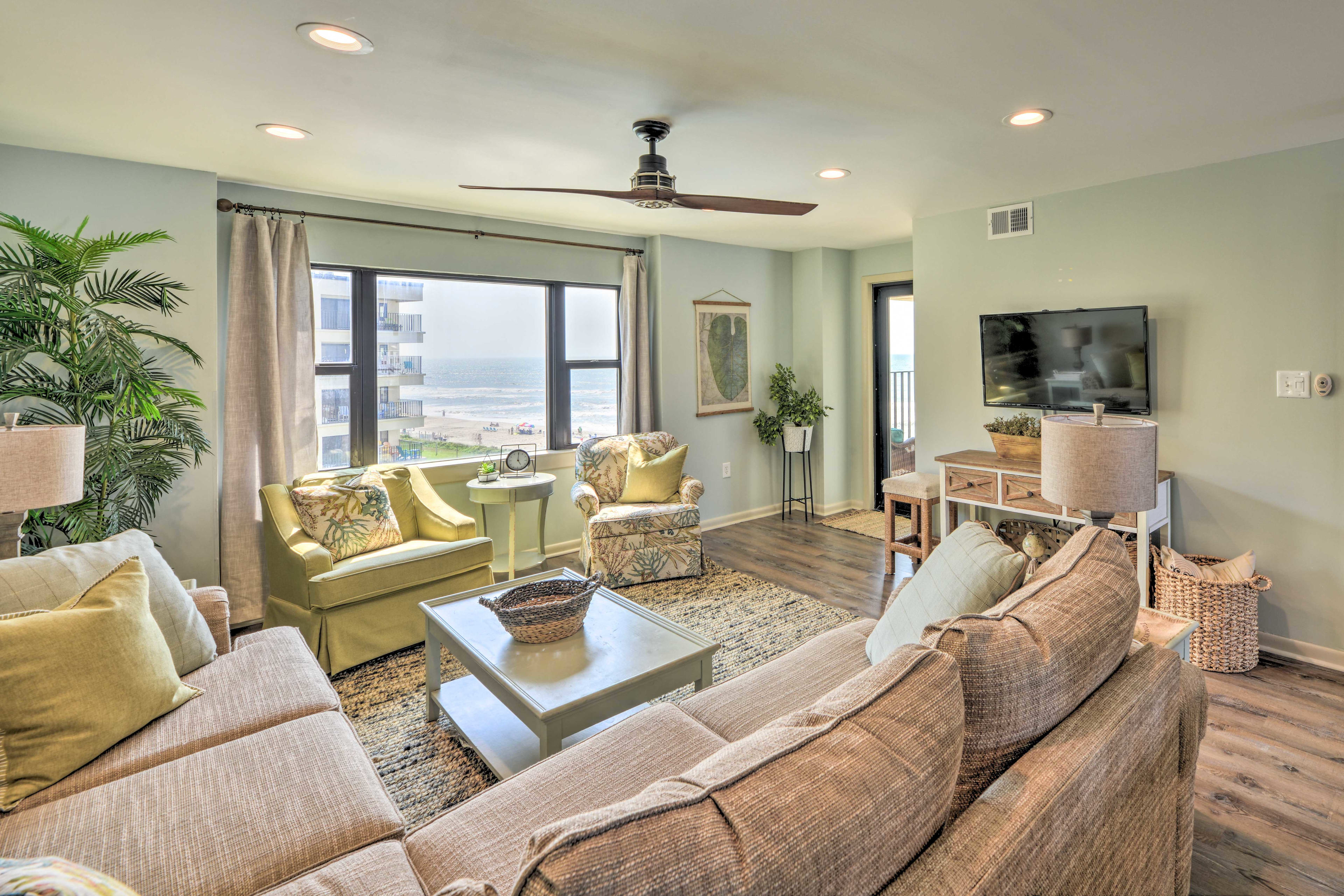 Unwind in the beautiful beach-themed interior of this fourth-story condo!